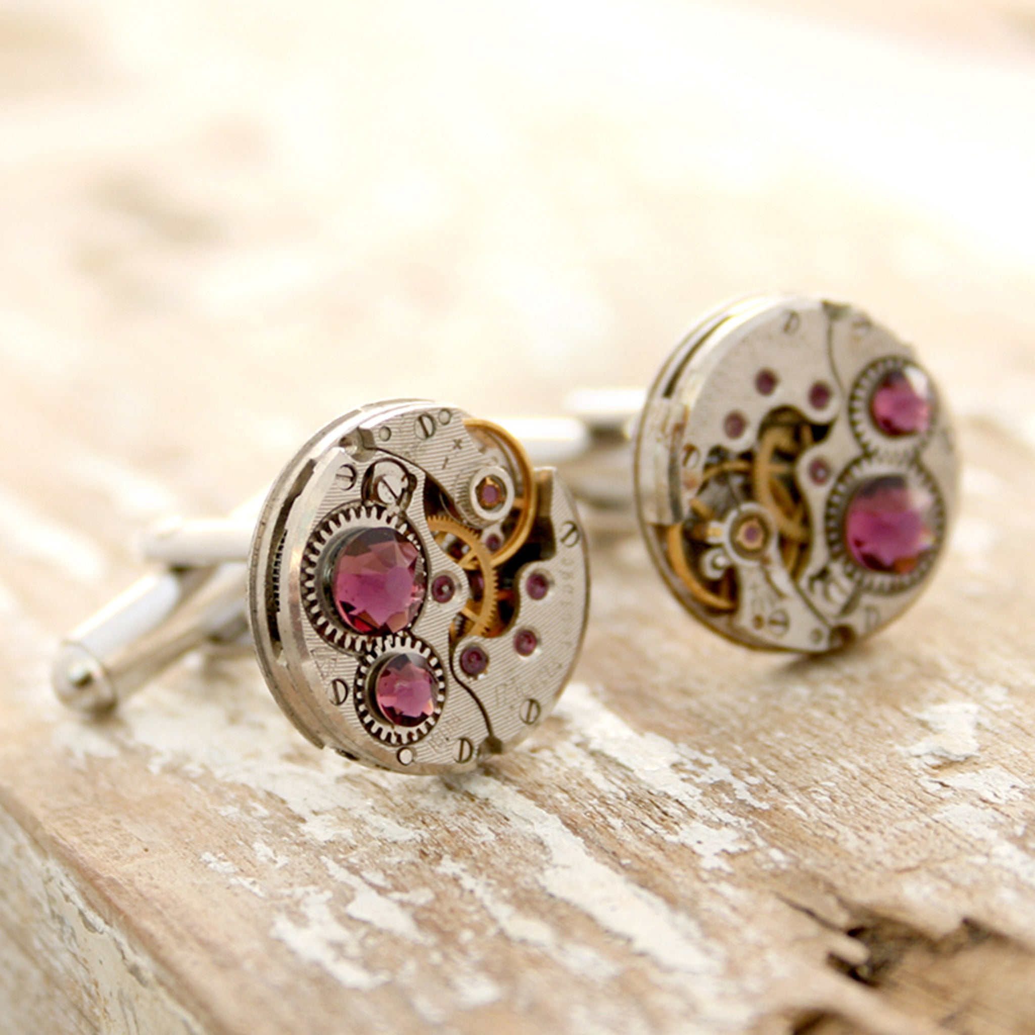 birthstone cufflinks in steampunk style featuring antique watch movements and Amethyst crystals