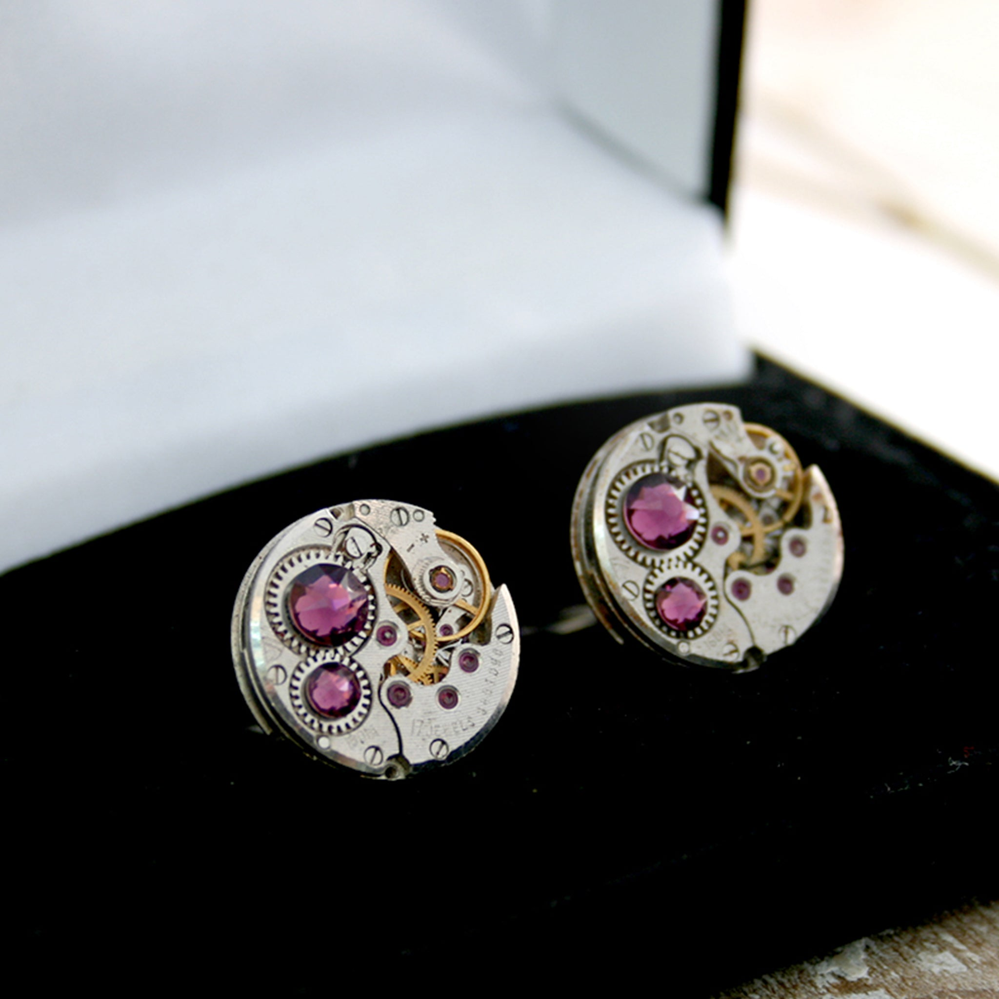 birthstone cufflinks in steampunk style featuring antique watch movements and Amethysts in a box