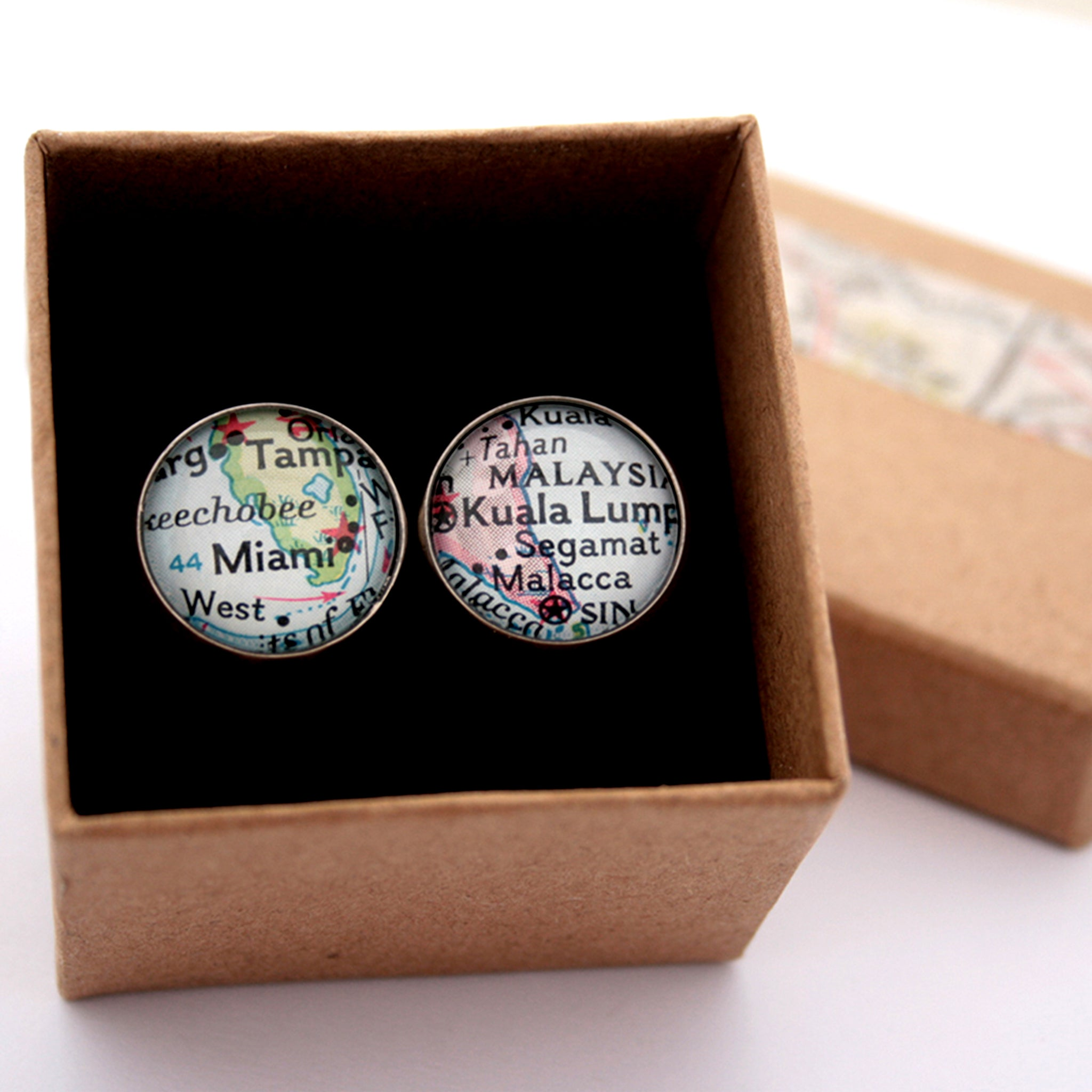 Personalised map cufflinks in silver tone featuring maps of Miami and Kuala Lumpur in a box