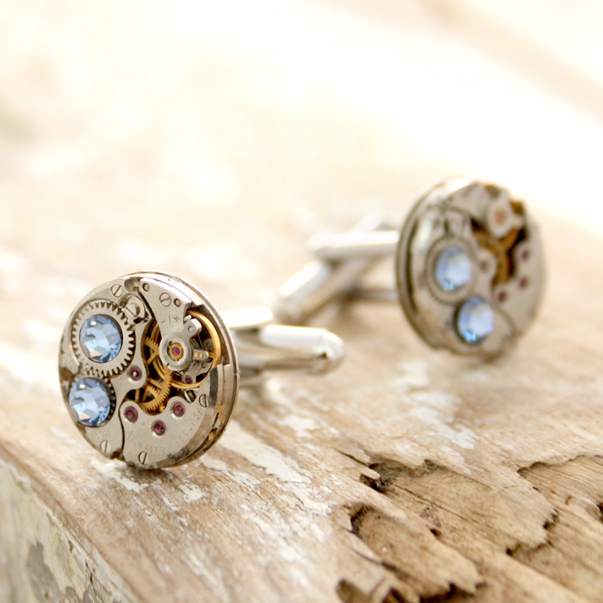 birthstone cufflinks in steampunk style featuring antique watch movements and Sapphire crystals
