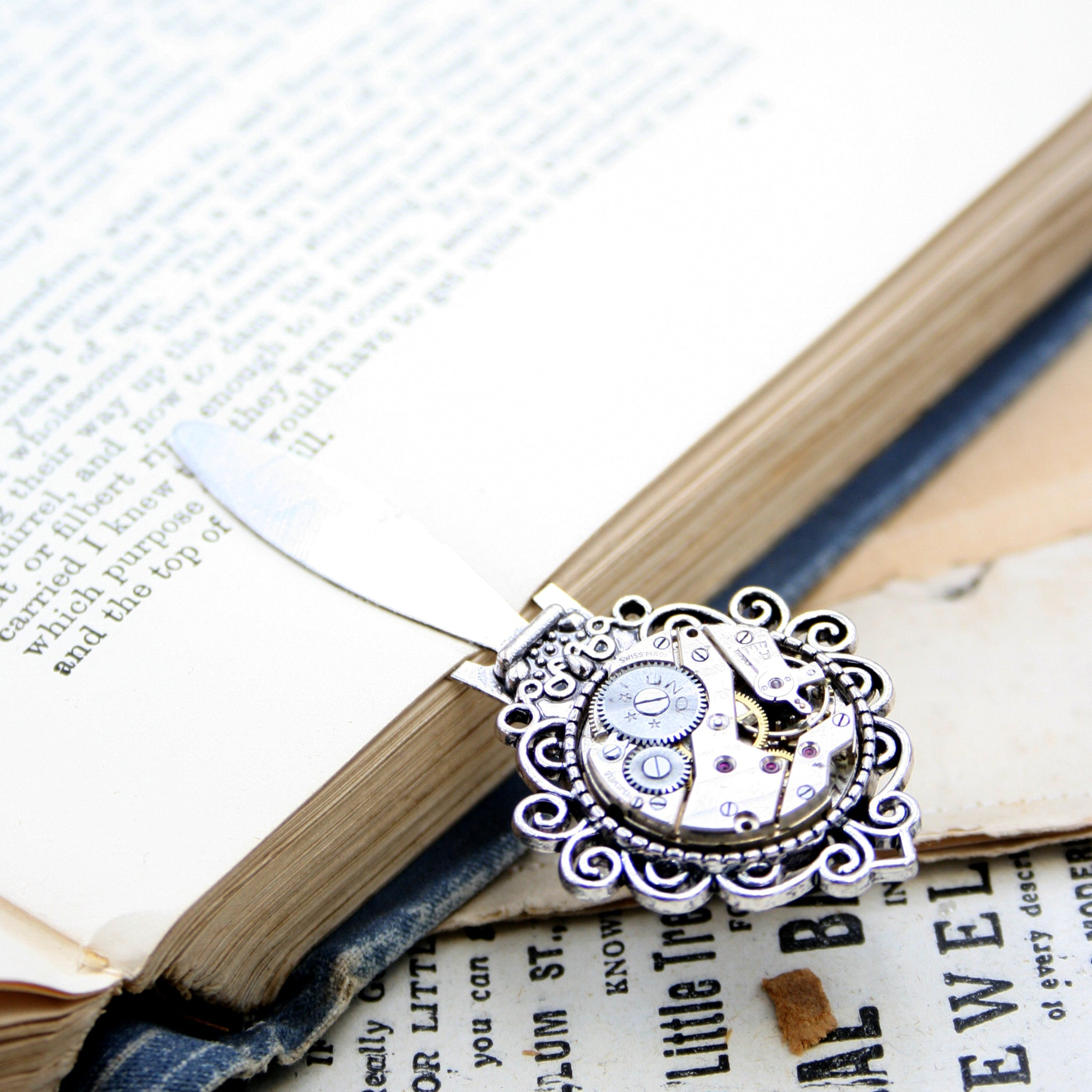 steampunk bookmark made of metal and antique watch movement