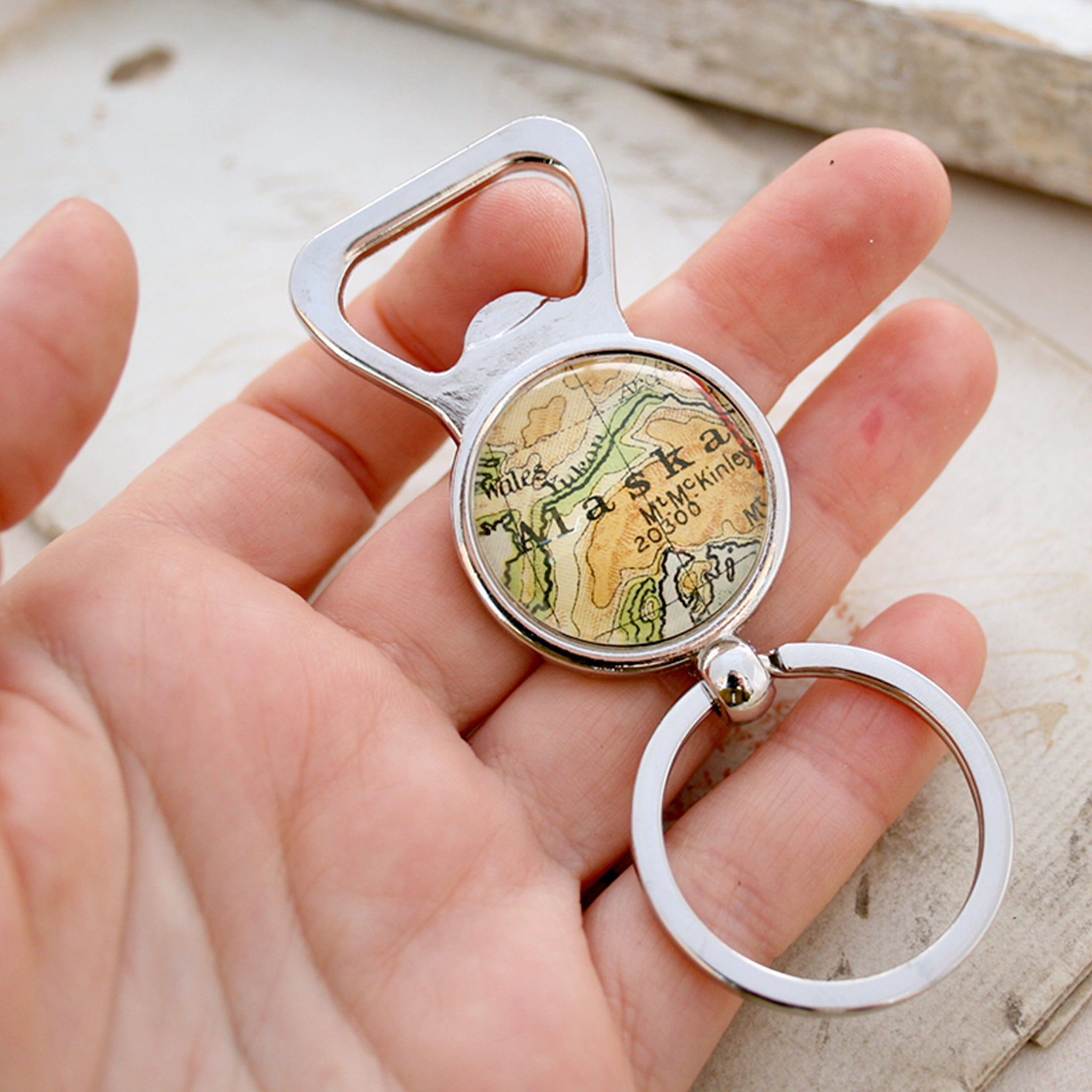 Hand holding personalised Bottle Opener with map of Alaska featured