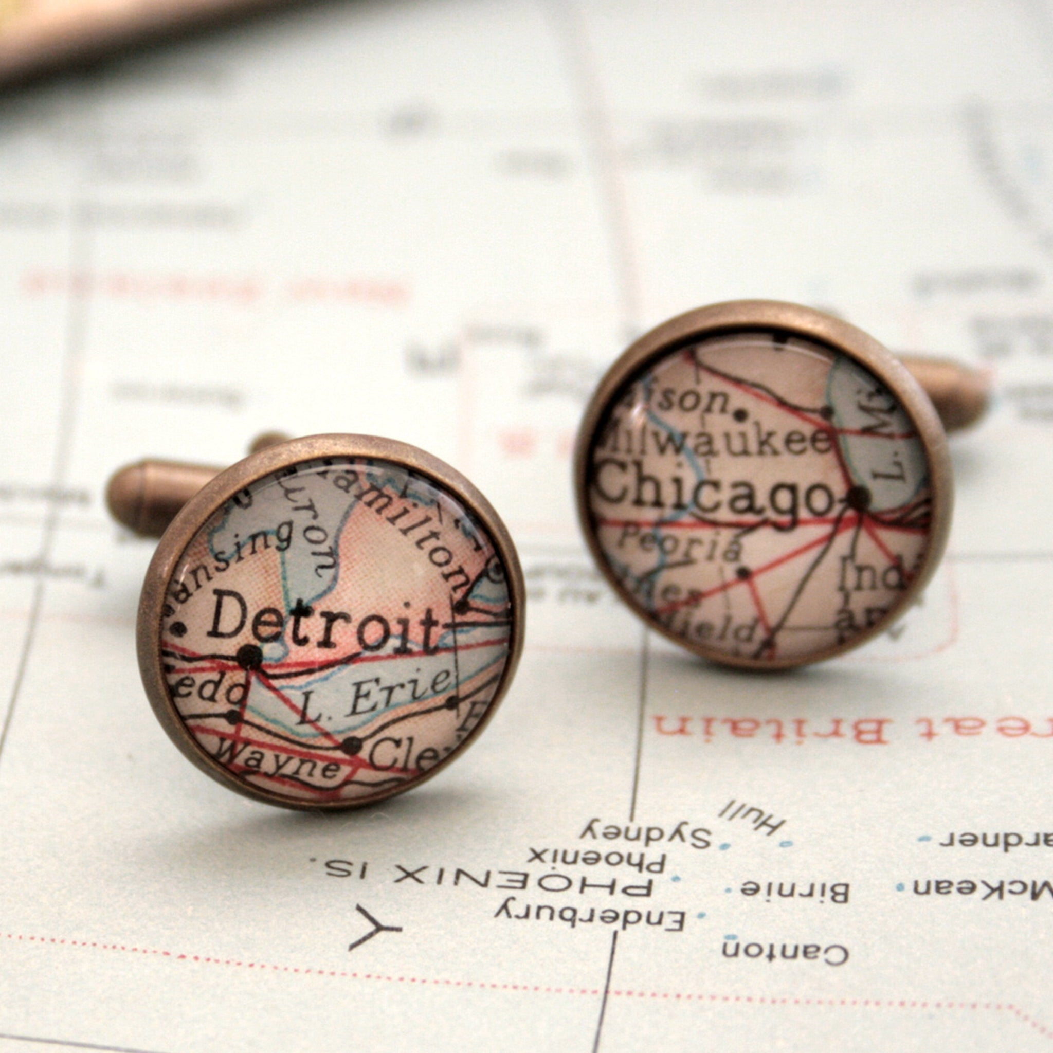 Personalised map cufflinks in antique bronze color featuring maps of Detroit and Chicago