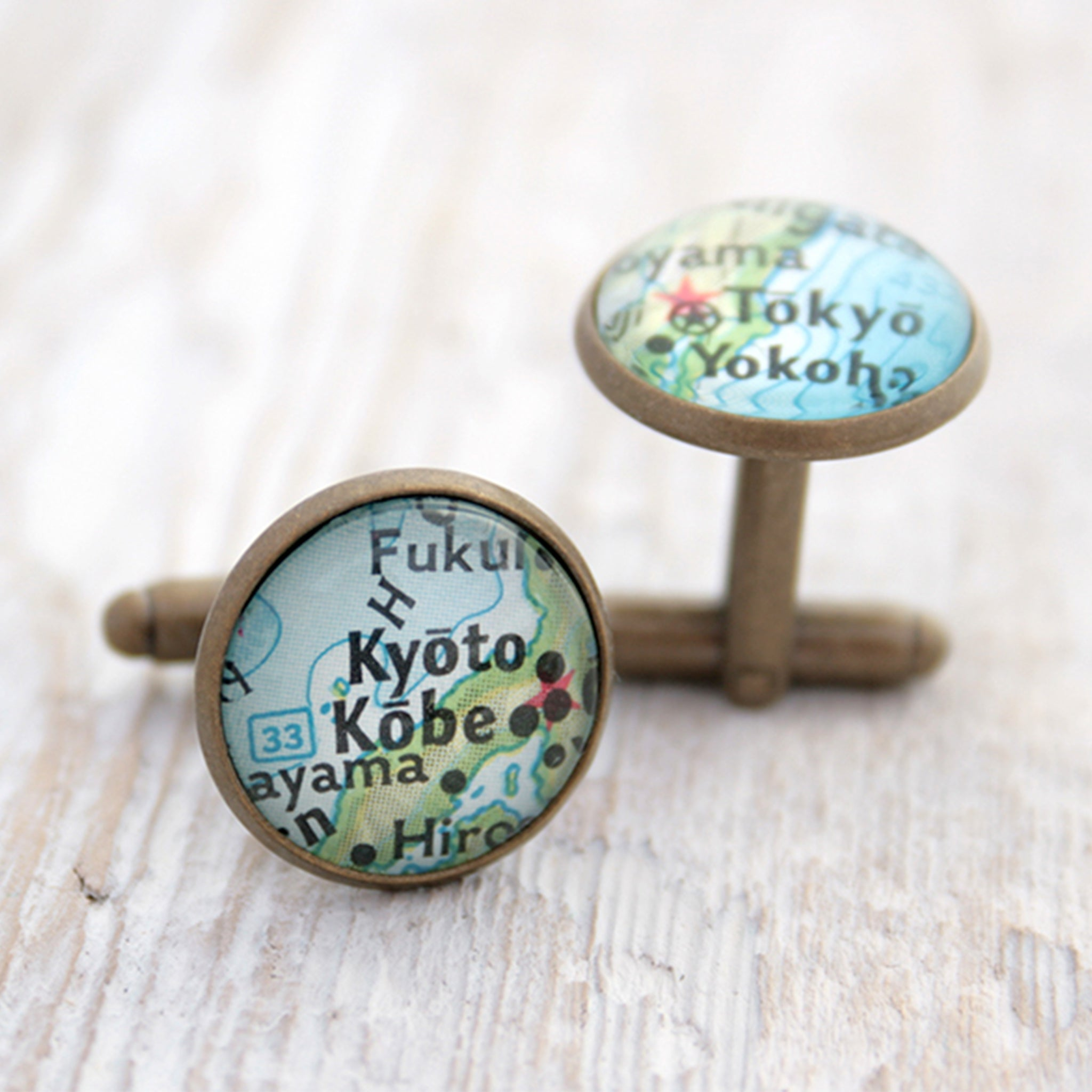Personalised map cufflinks in antique bronze color featuring maps of Kyoto and Tokyo
