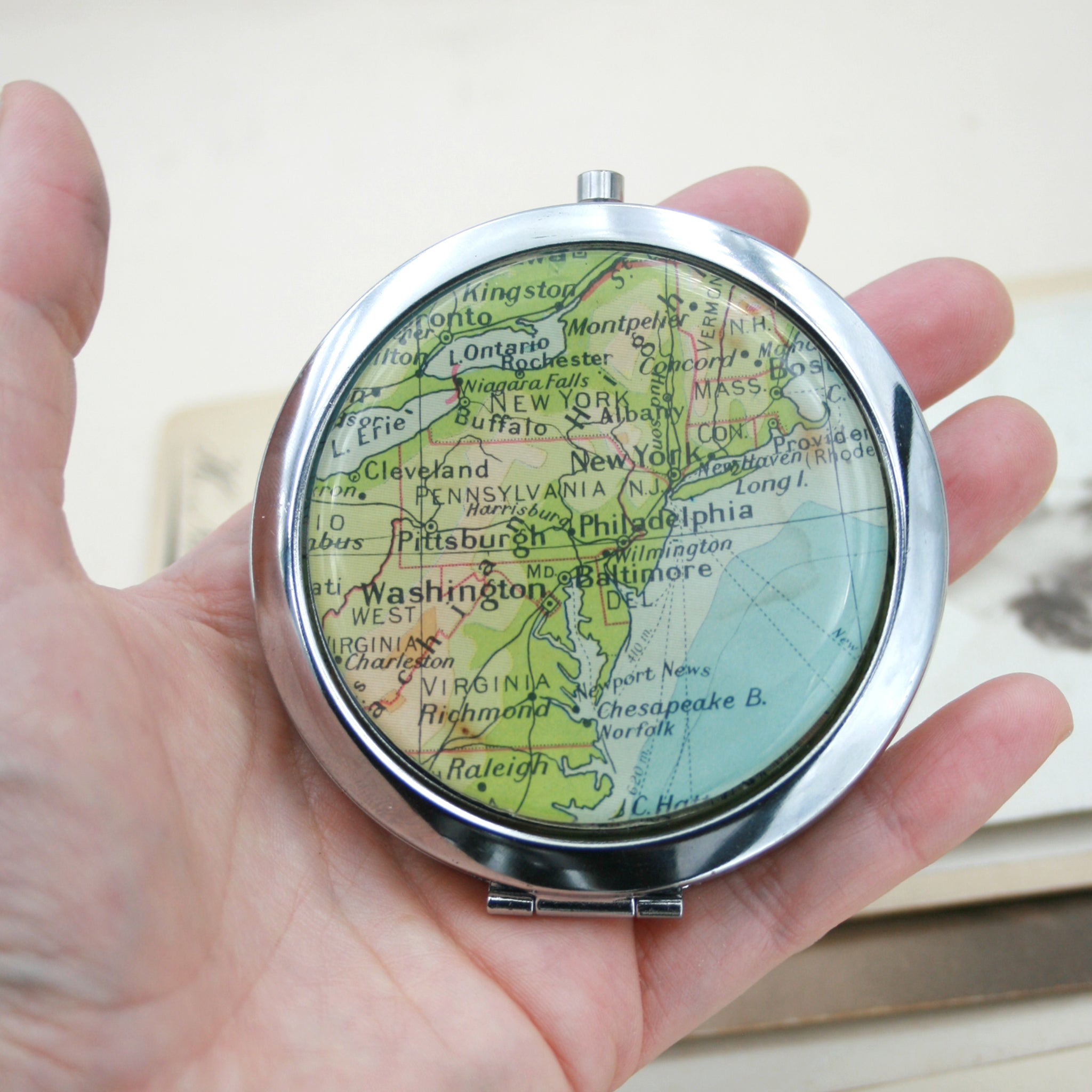 Hold in hand Personalised Compact Mirror in silver color featuring map of New York