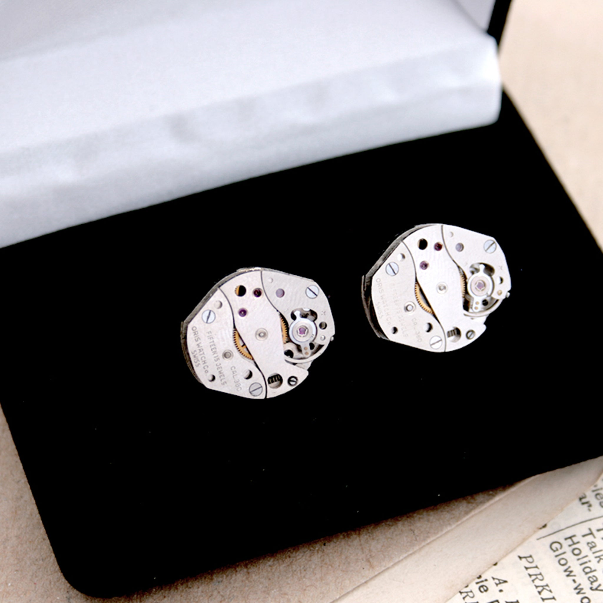 cool watch cufflinks for men featuring antique movements in black velour box