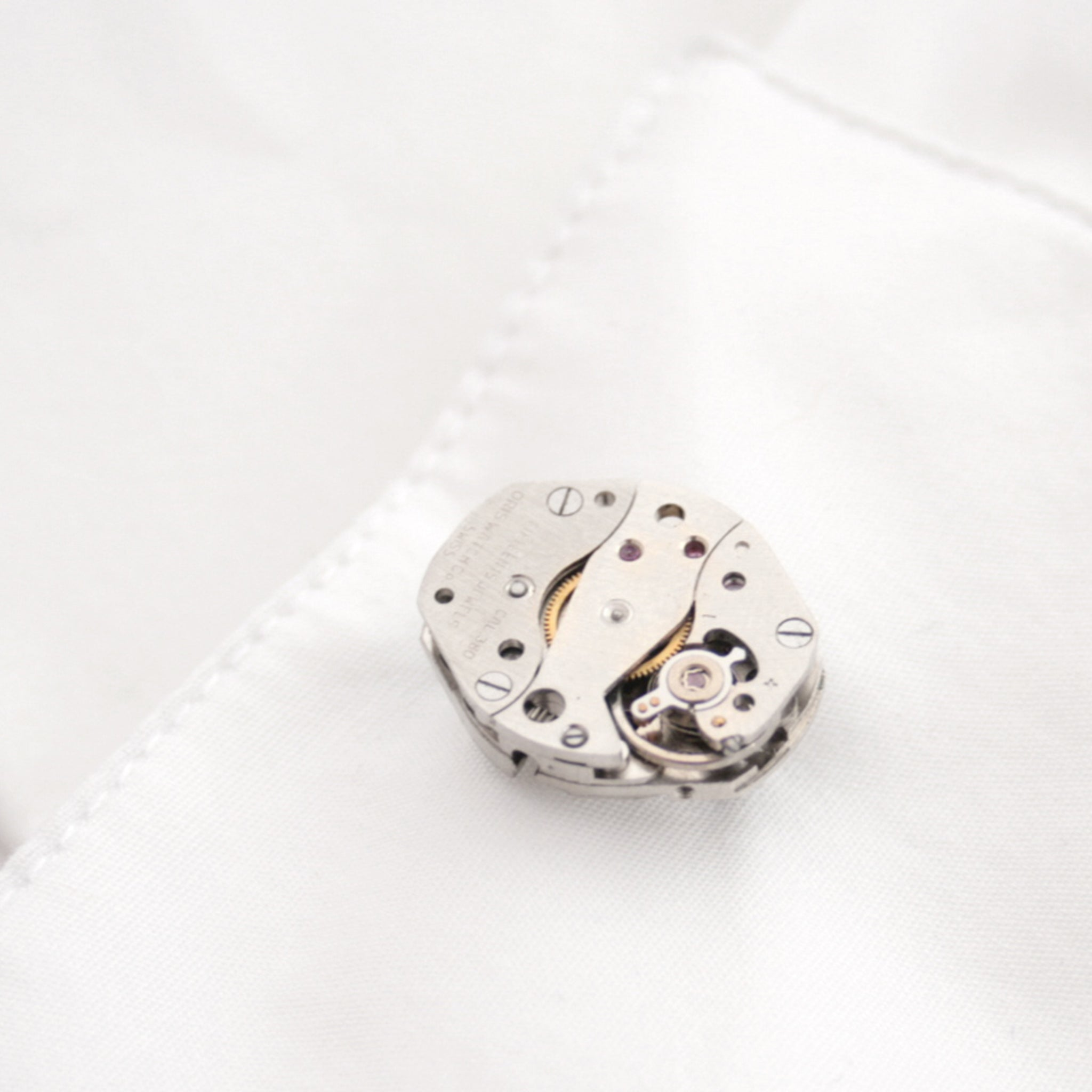 cool watch cufflinks for men featuring antique movements in shirt's cuff