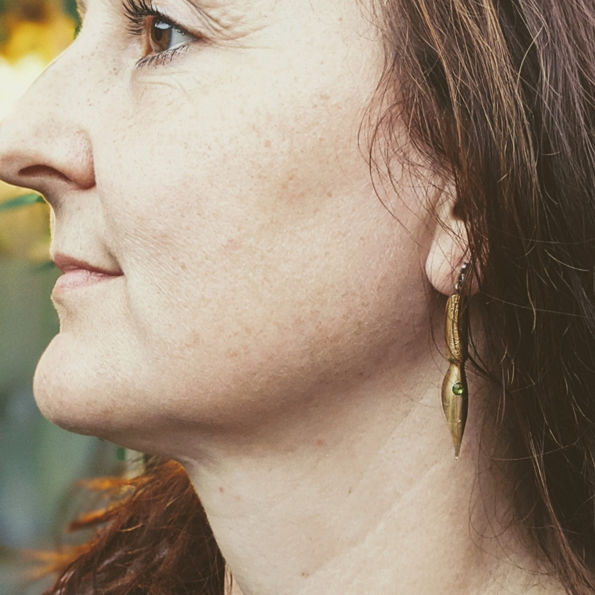 Woman wearing Dark Academia Olivine & Pen Nib Earrings