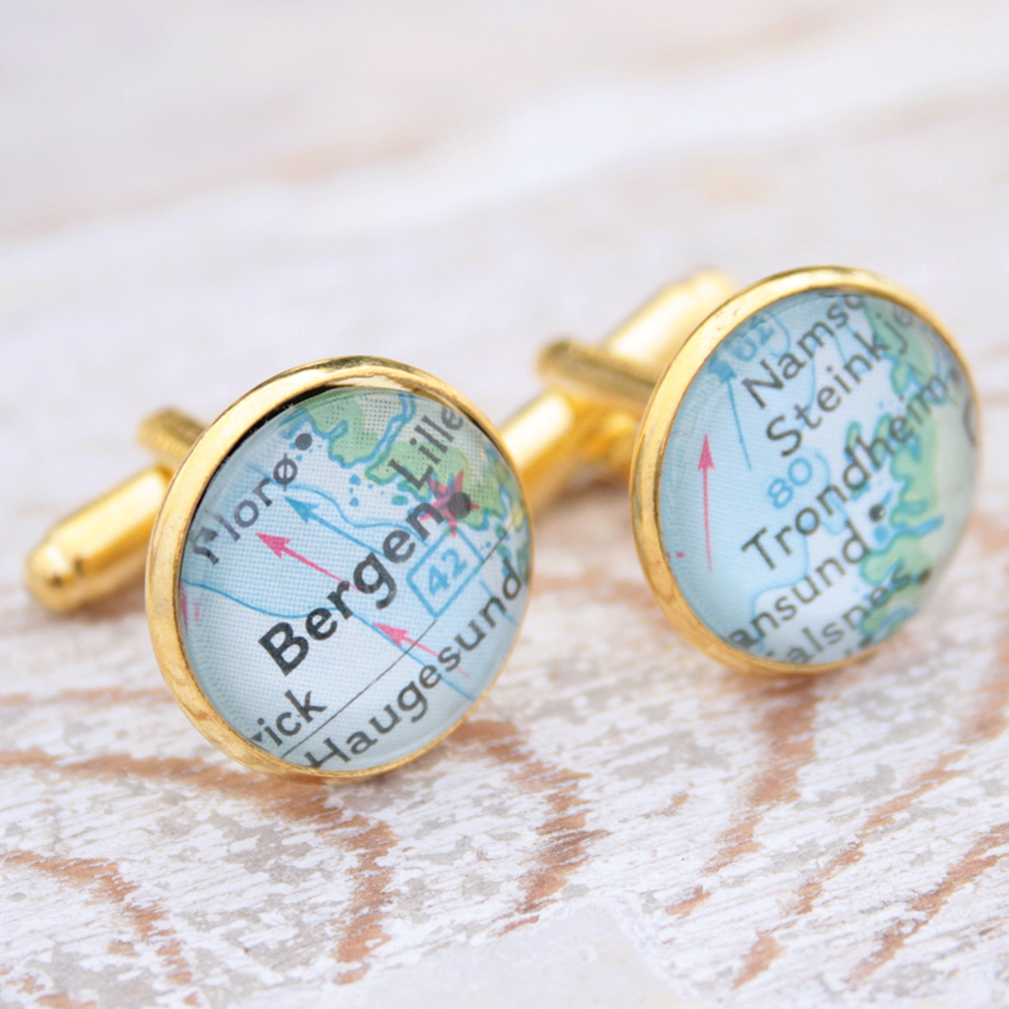 Personalised map cufflinks in gold color featuring maps of Bergen and Trondheim