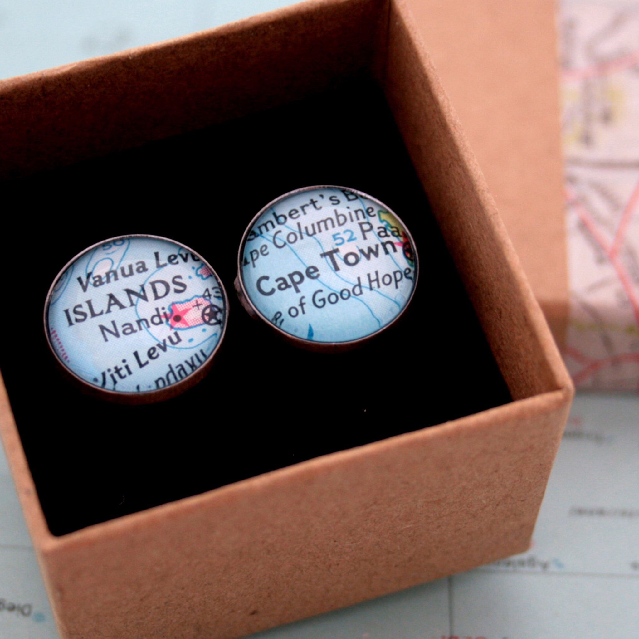 Personalised map cufflinks in gunmetal color featuring custom maps in a box