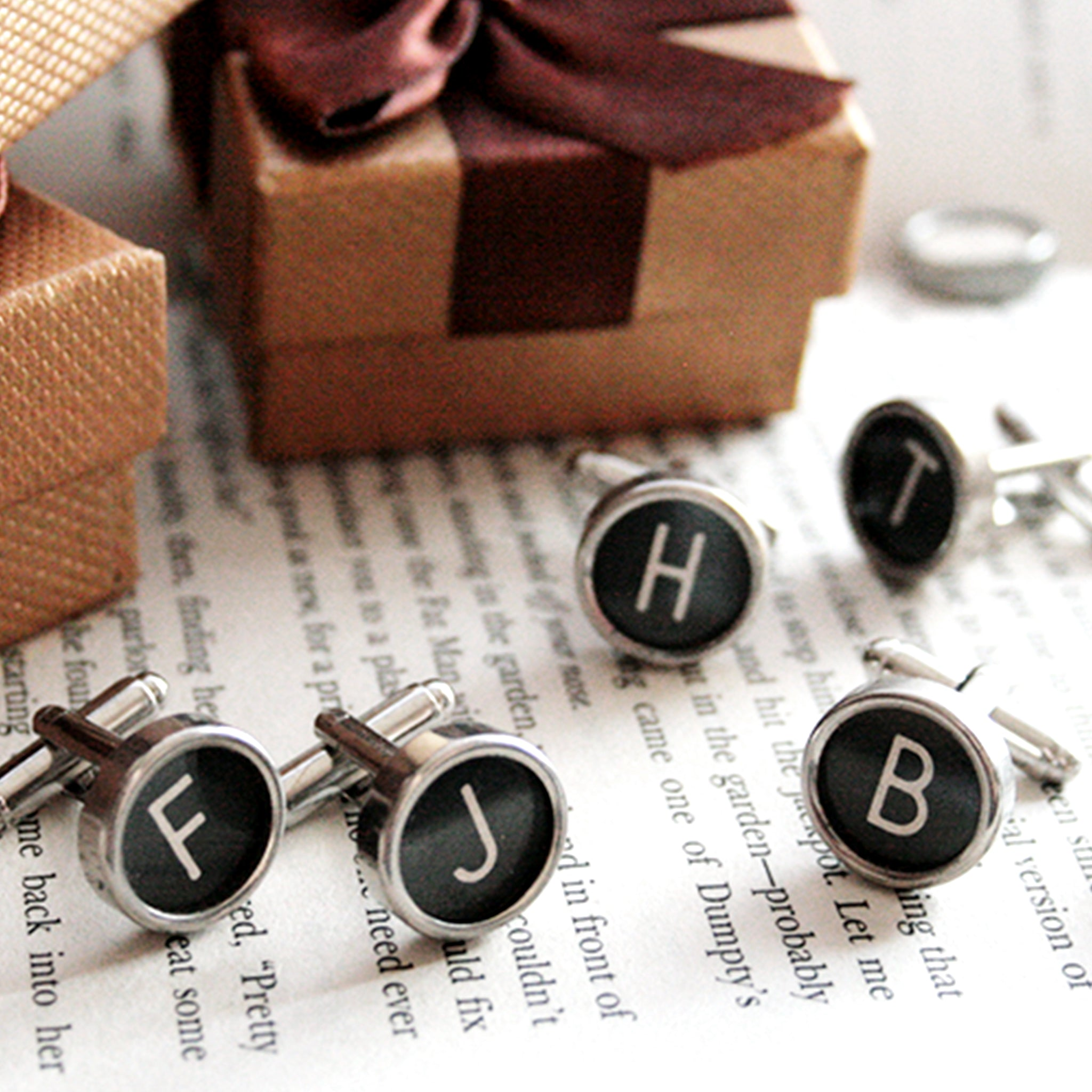 Many sets of cufflinks with initials made of real typewriter keys