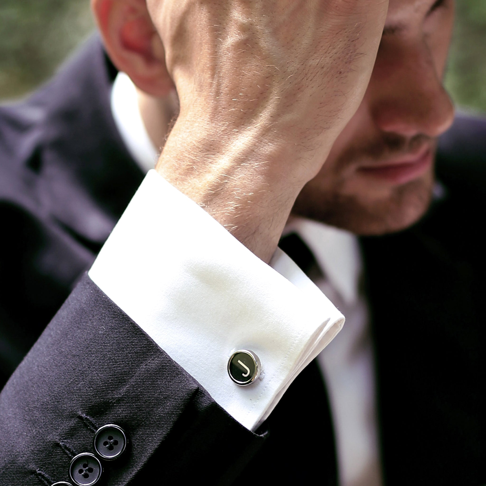 Man wearing Black Personalised cufflinks with initials made of real typewriter keys