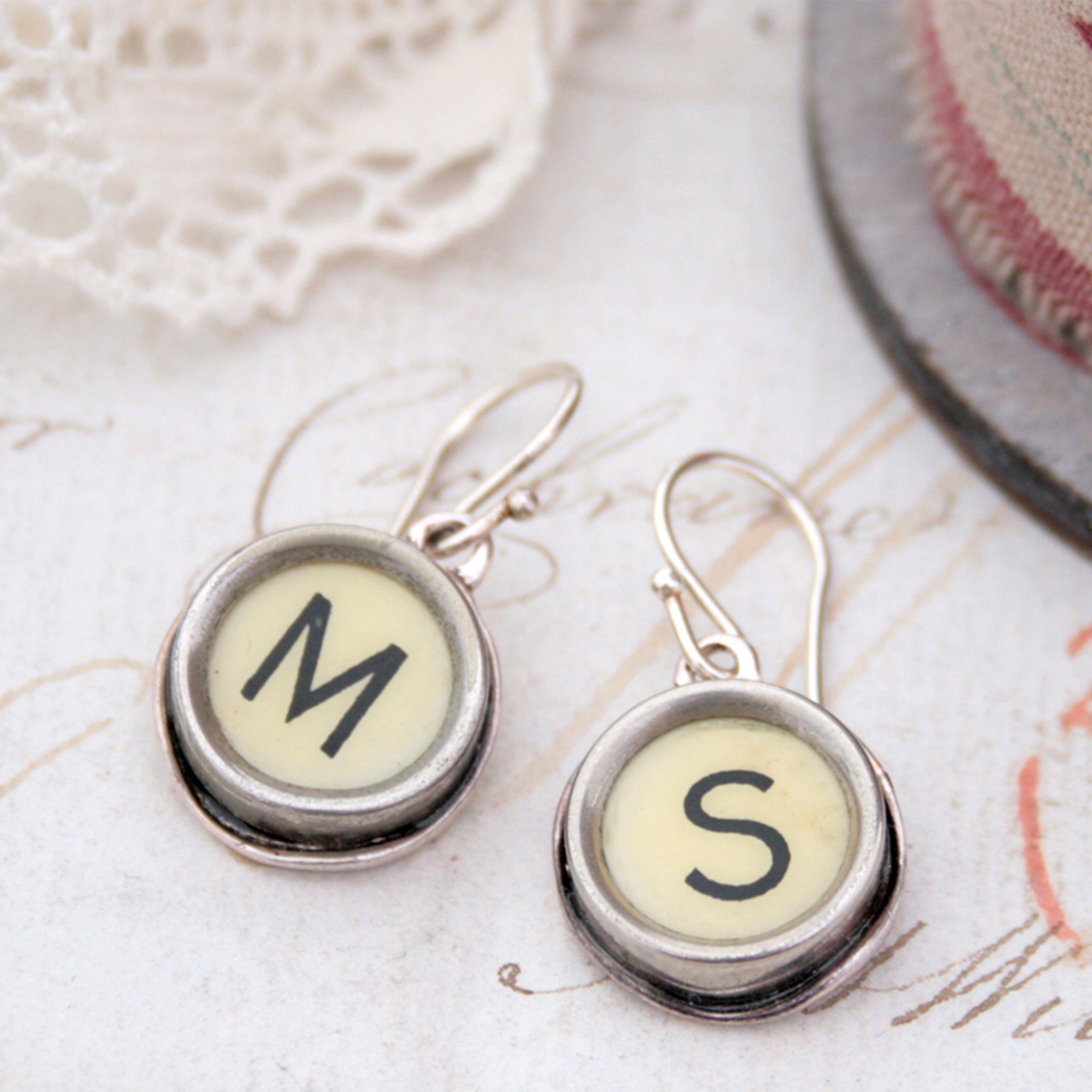 personalised initial earrings made of real typewriter keys M and S