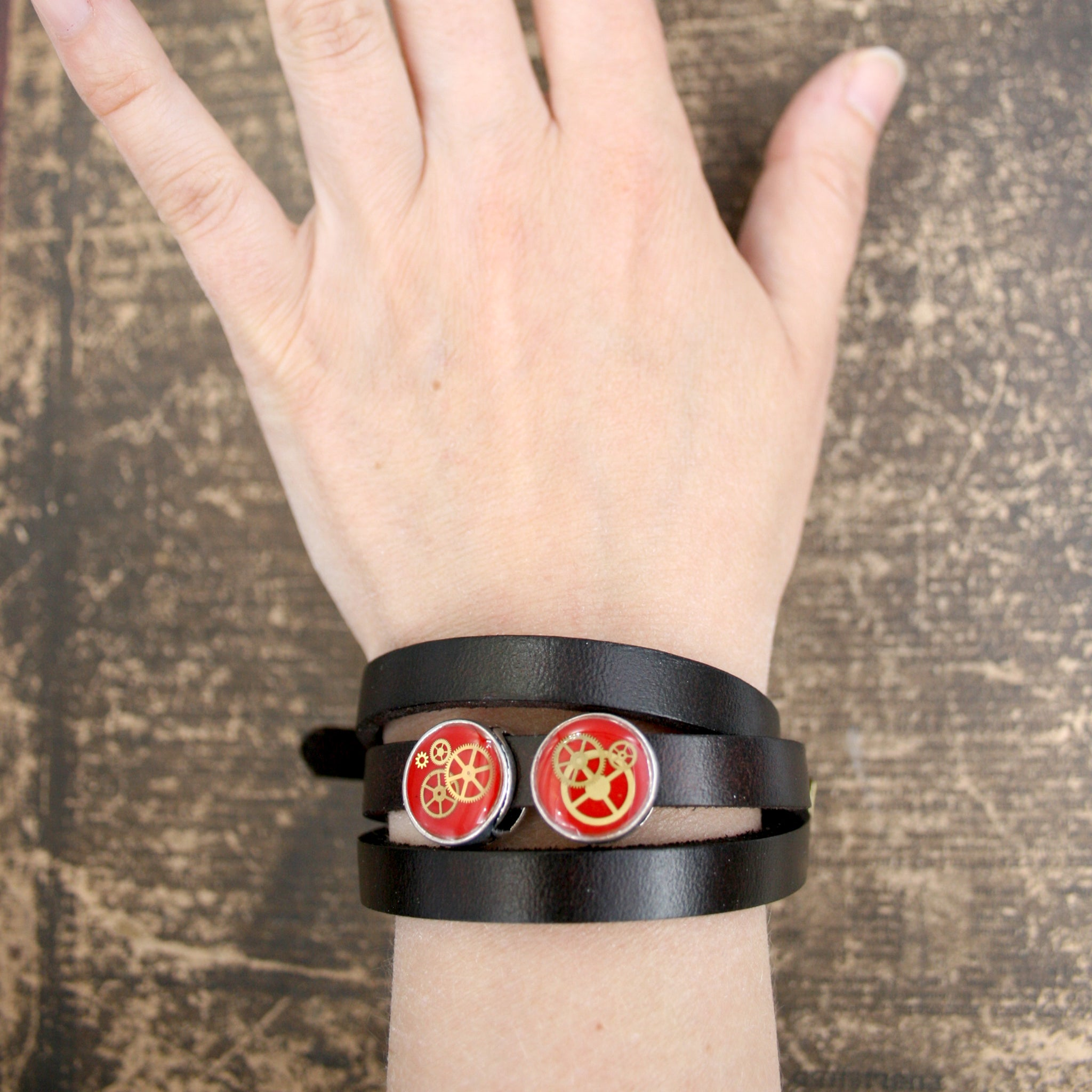Steampunk Mens Black Leather Bracelet with red slider beads and real watch parts on hand