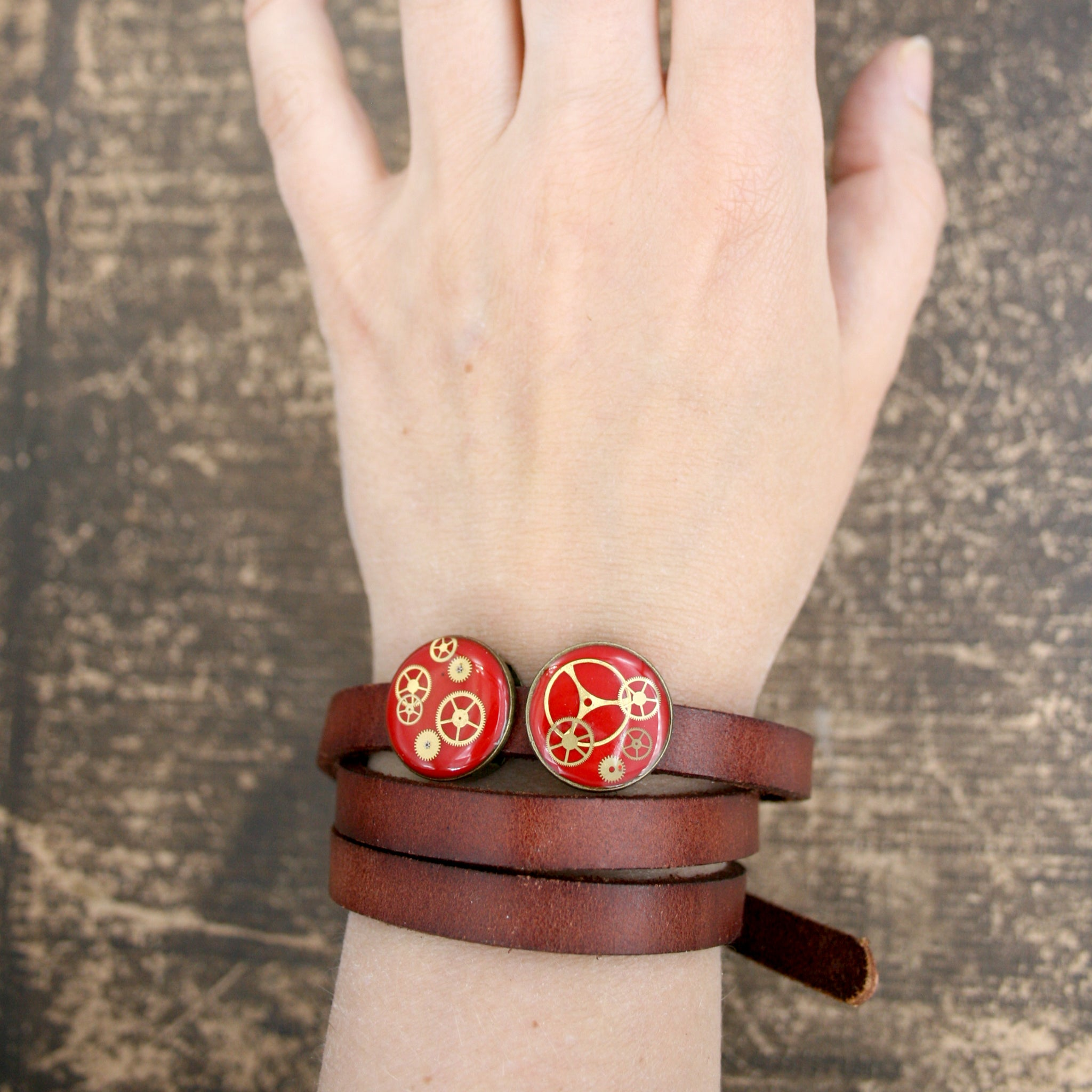 Steampunk Mens Brown Leather Bracelet with red slider beads and real watch parts on hand