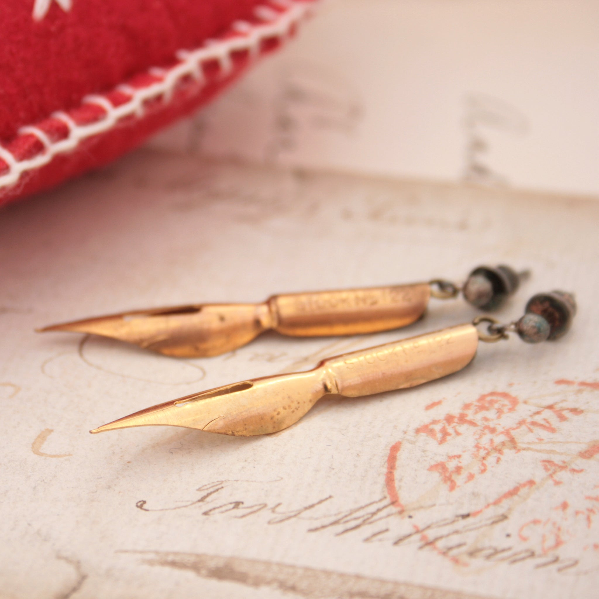 Long Dangle Earrings made of antique pen nibs in gold color