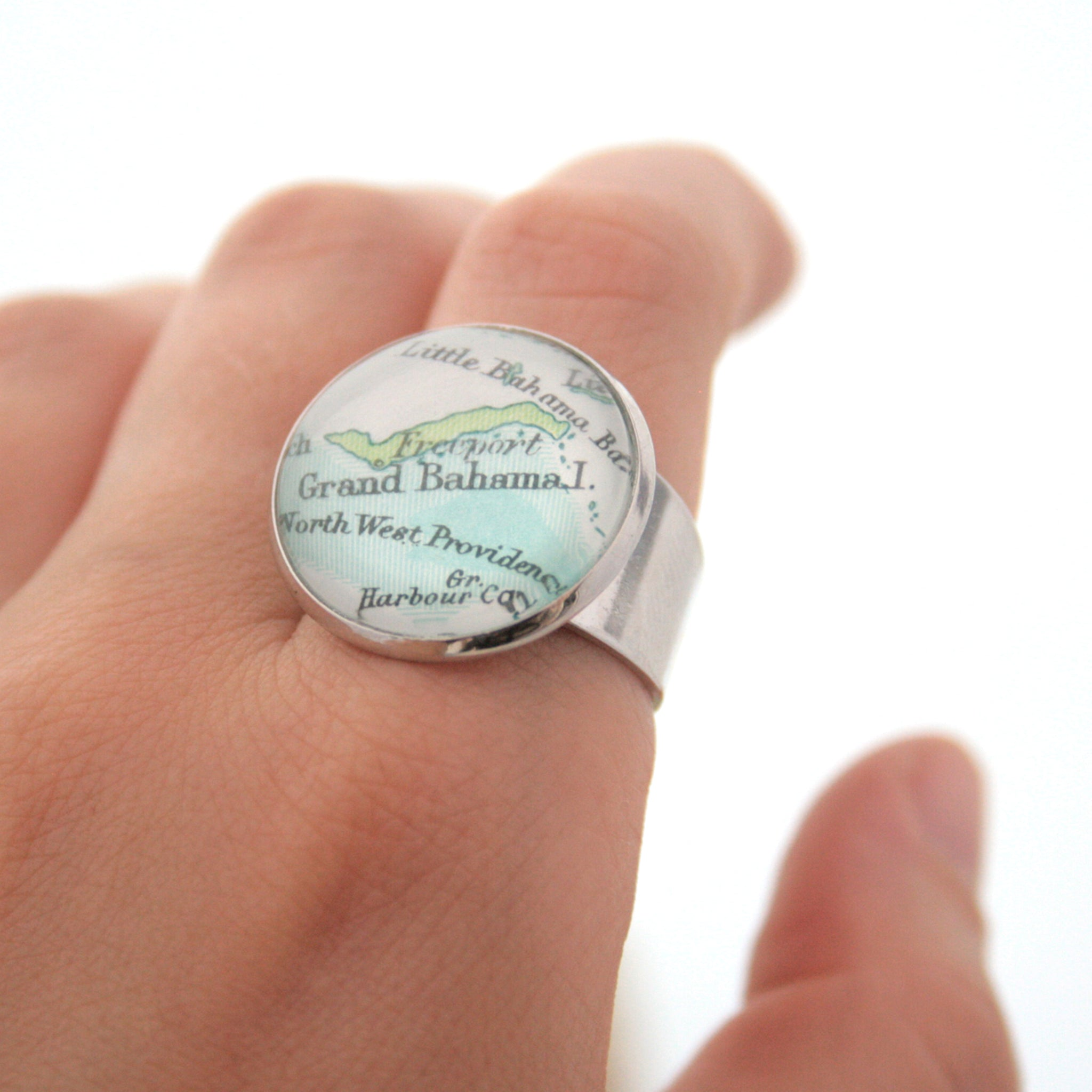 Silver ring featuring map of Grand Bahama worn on hand