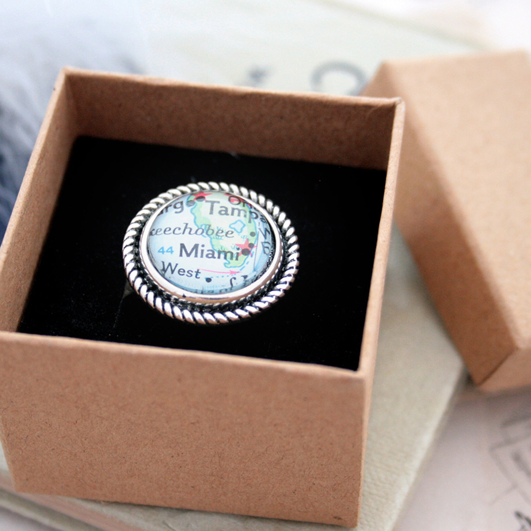 Silver tone ring with rope pattern featuring map of Miami in a box