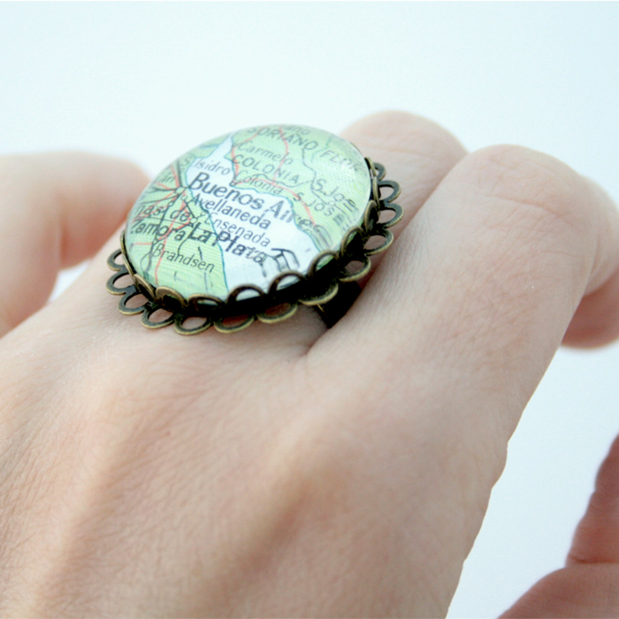 Round bronze ring personalised with custom map of Buenos Aires worn on hand