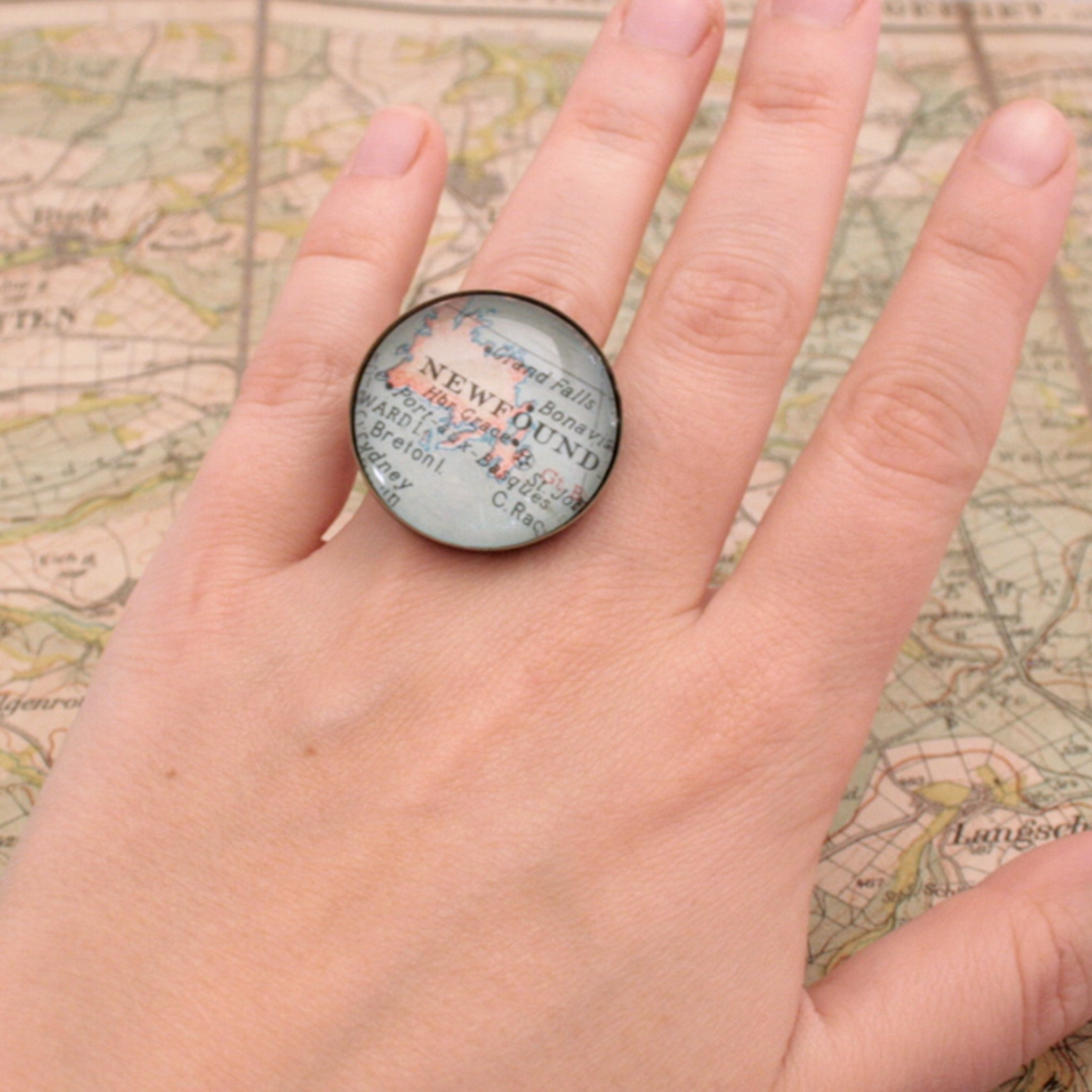 Round bronze ring personalised with custom map of Newfoundland worn on hand