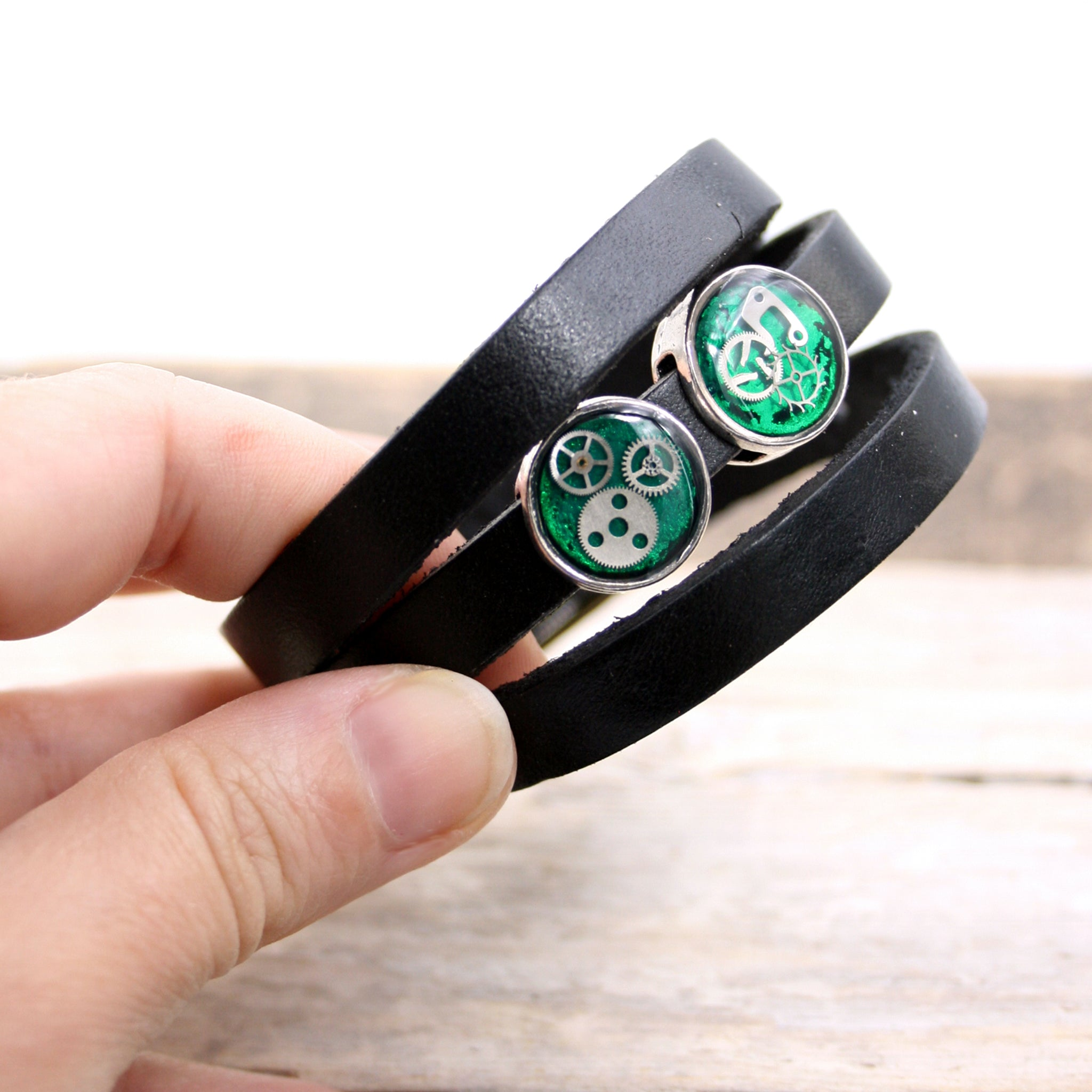 Black leather triple wrap bracelet with green steampunk slider beads with watch parts