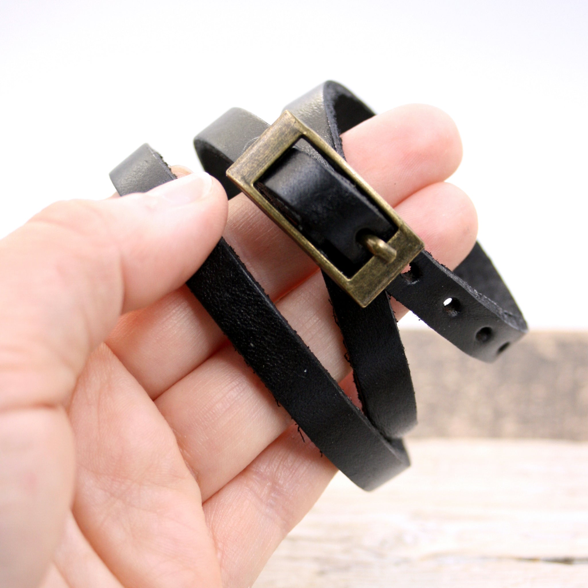 Black leather triple wrap bracelet buckle