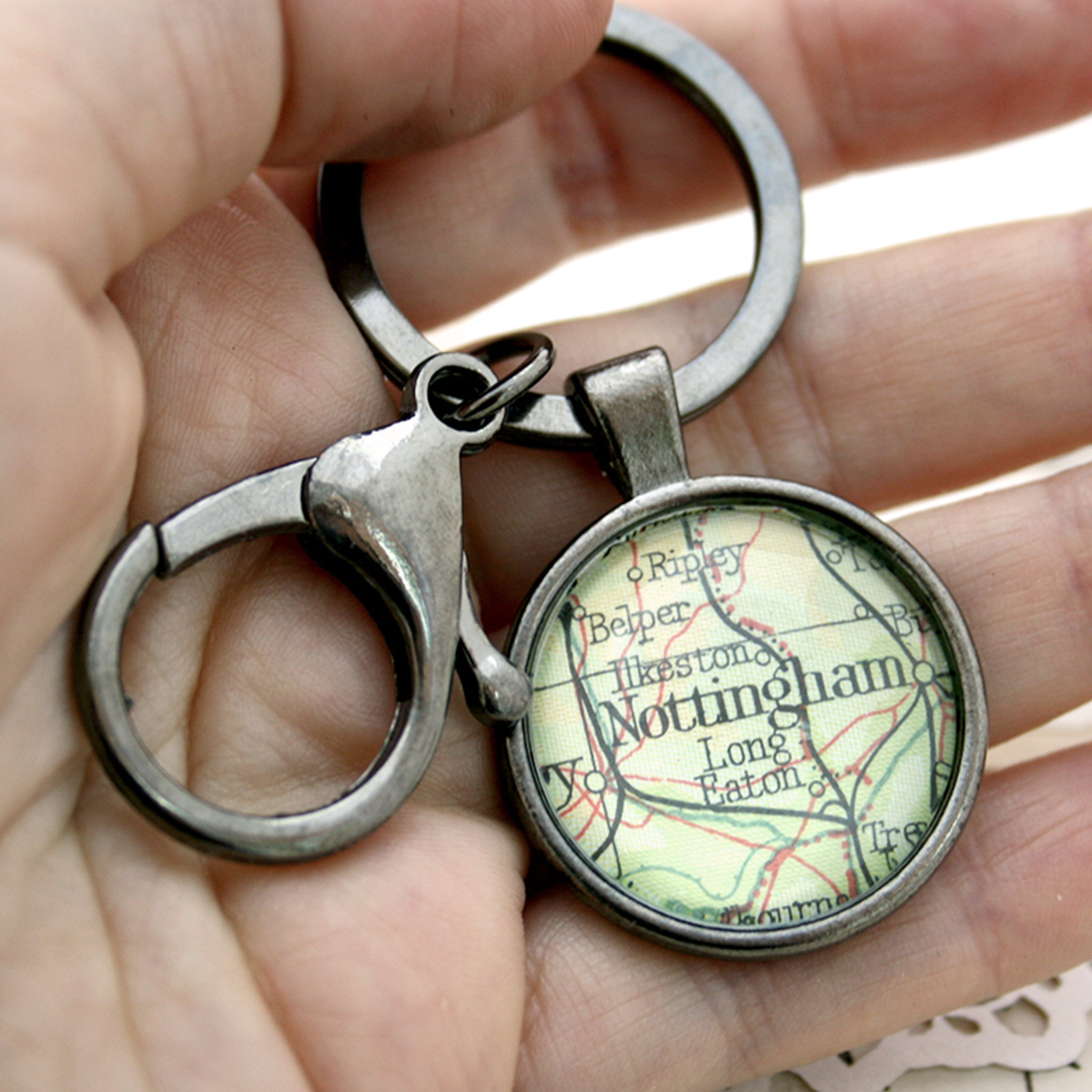 Hold in hand Personalised keyring in gunmetal black color featuring map of Nottingham