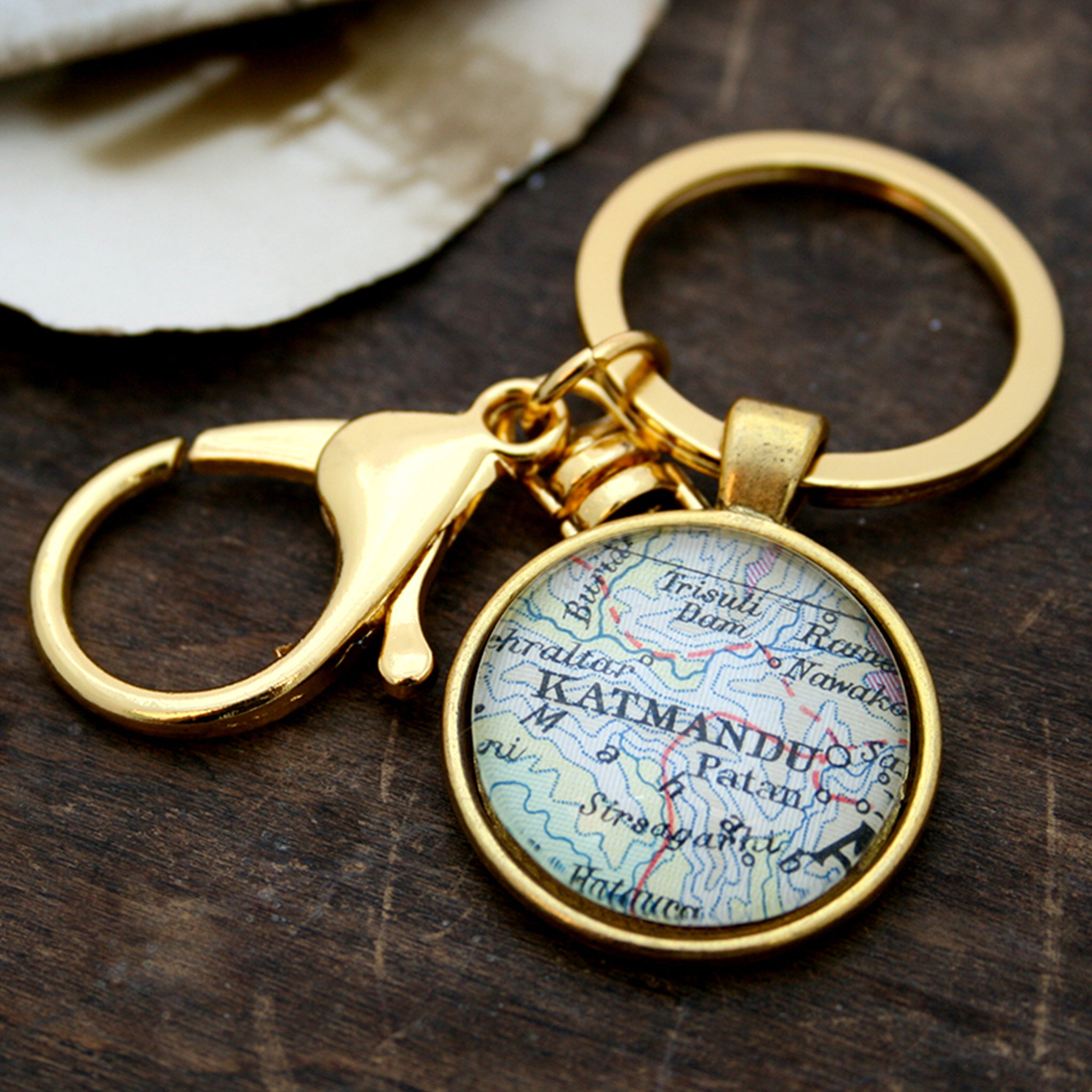 Personalised keyring in gold color featuring map of Kathmandu
