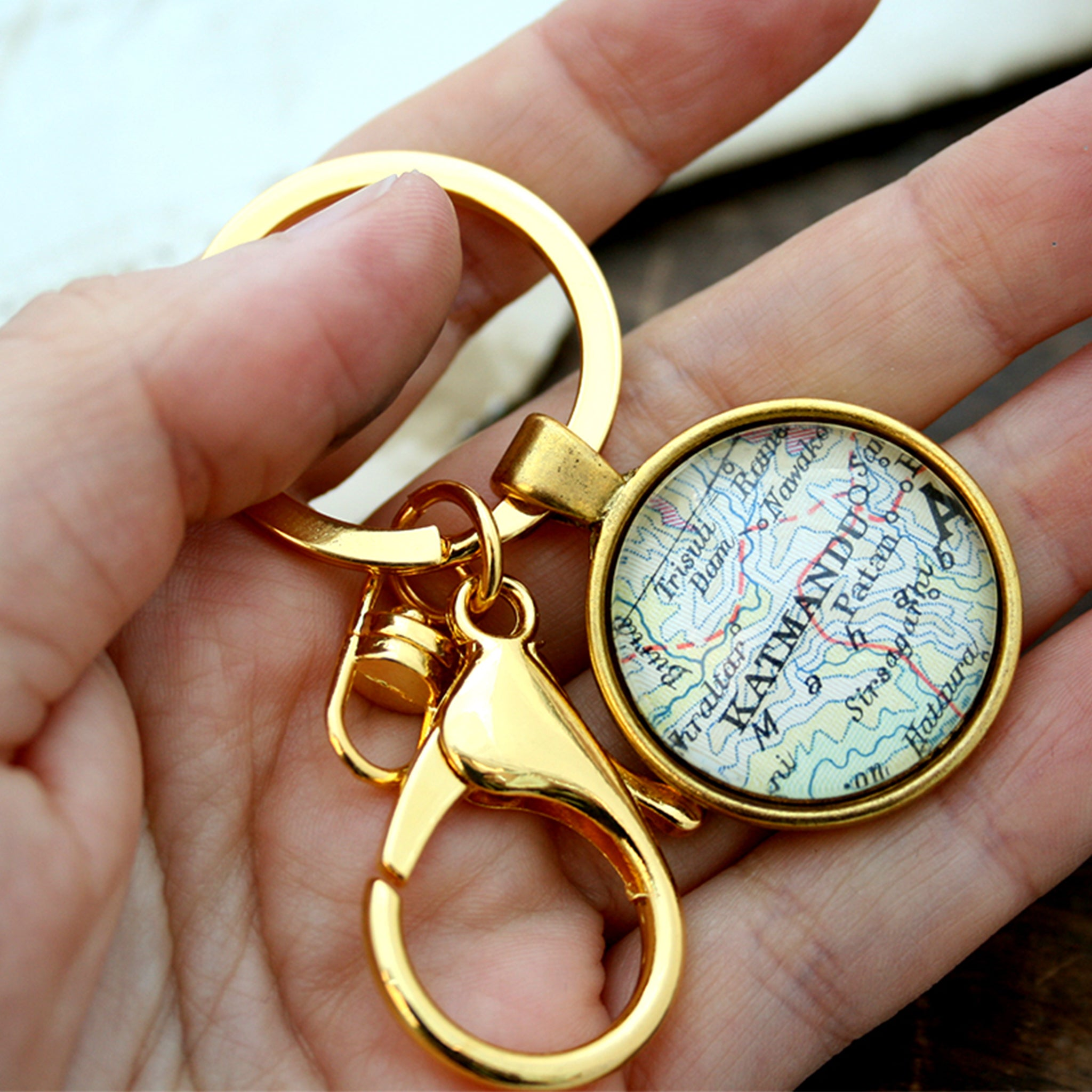 Hold in hand Personalised keyring in gold color featuring map of Kathmandu