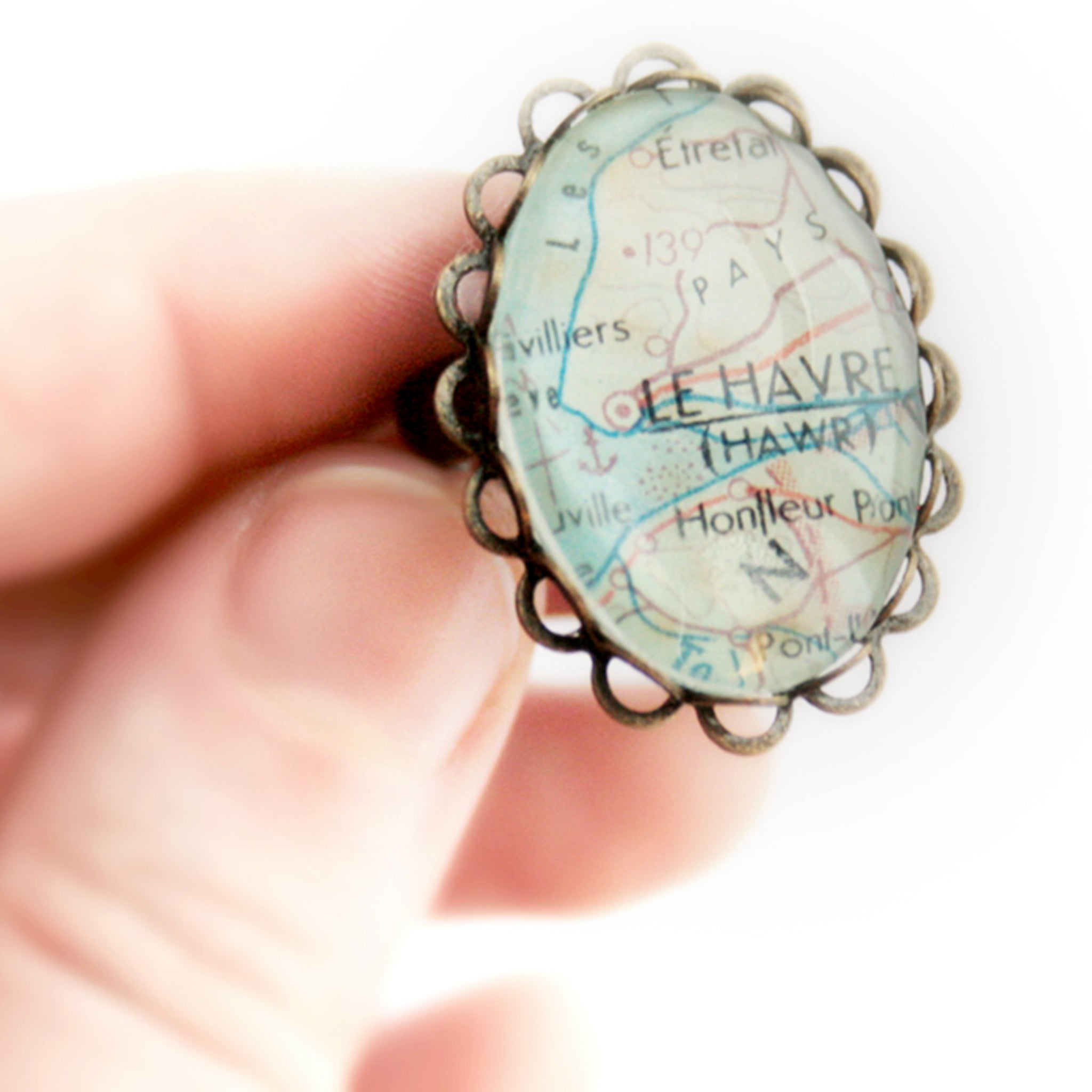 Hand holding Oval bronze personalised ring featuring map of Le Havre