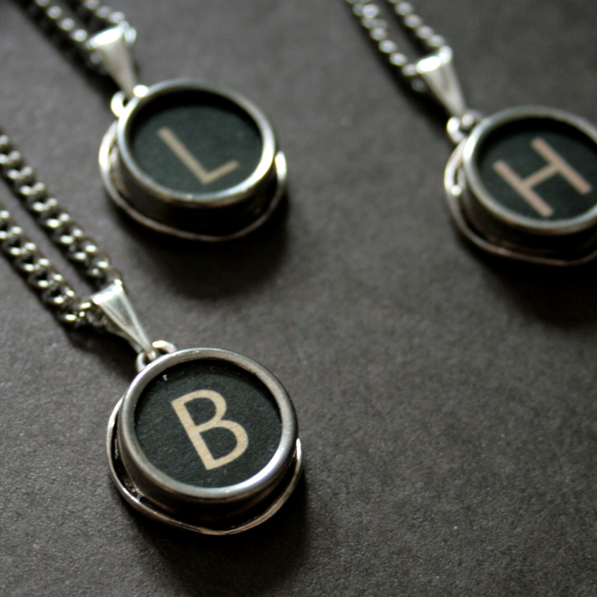 initial necklace made of authentic vintage black typewriter key