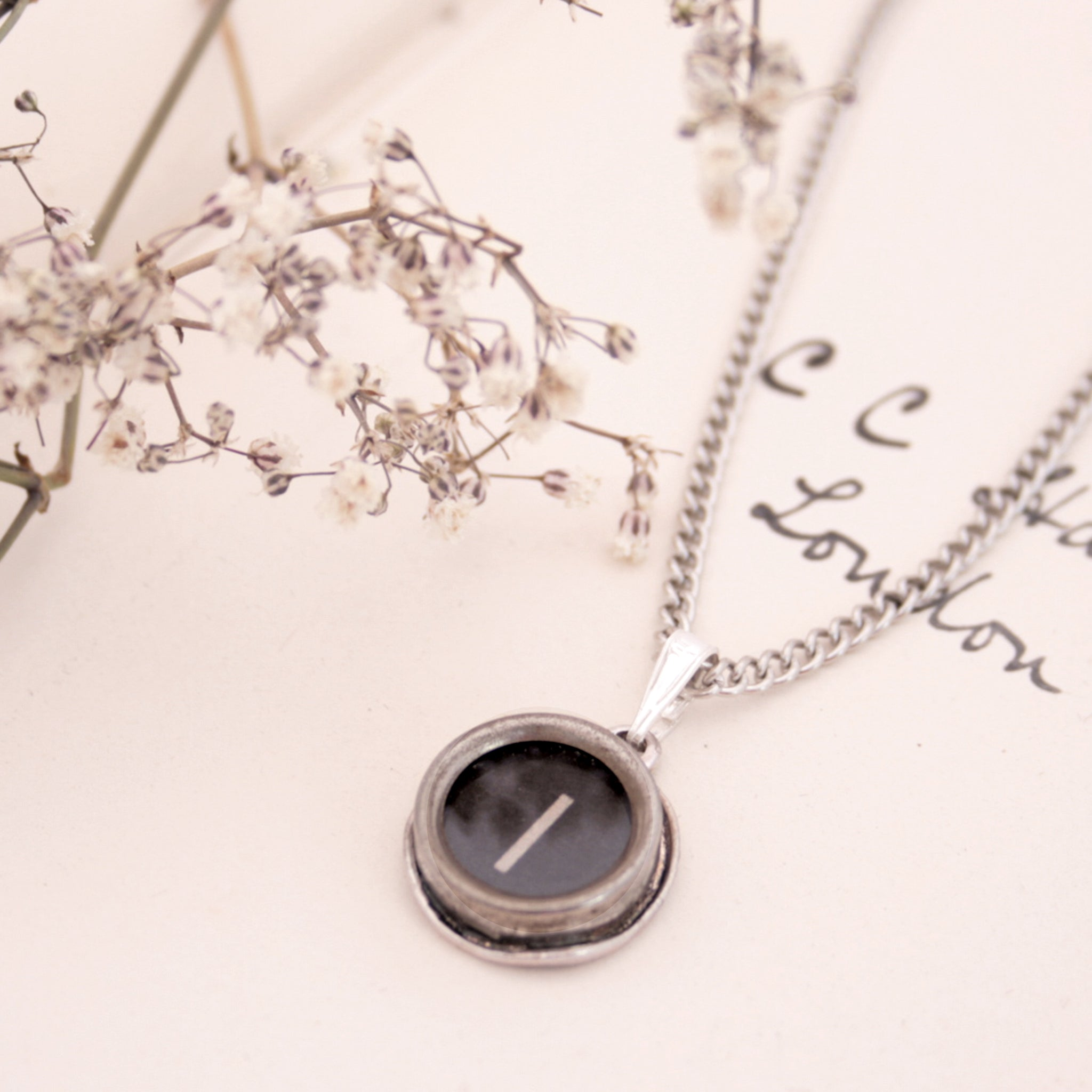 I initial necklace made of authentic vintage black typewriter key