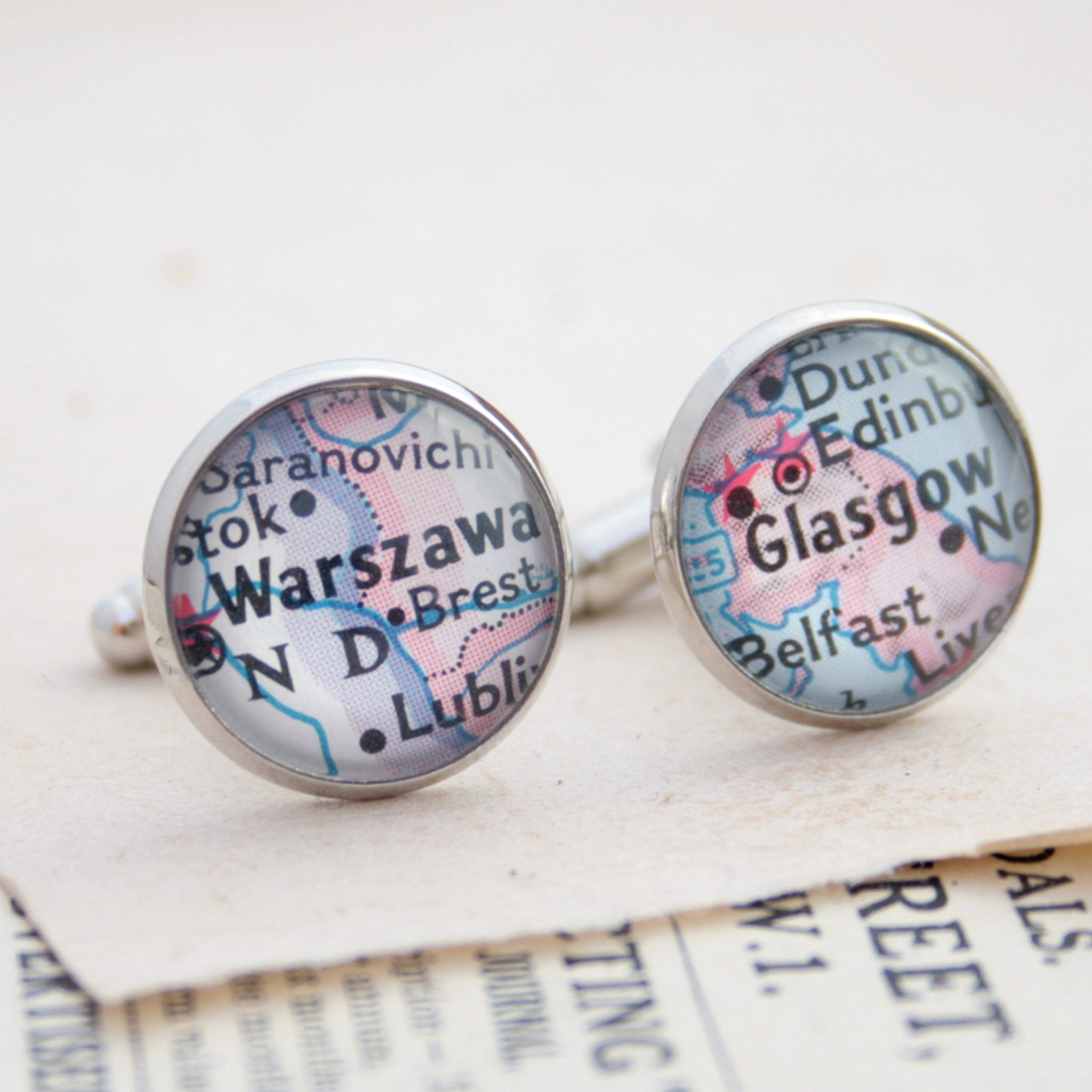Personalised map cufflinks in silver tone featuring maps of Warszawa and Glasgow