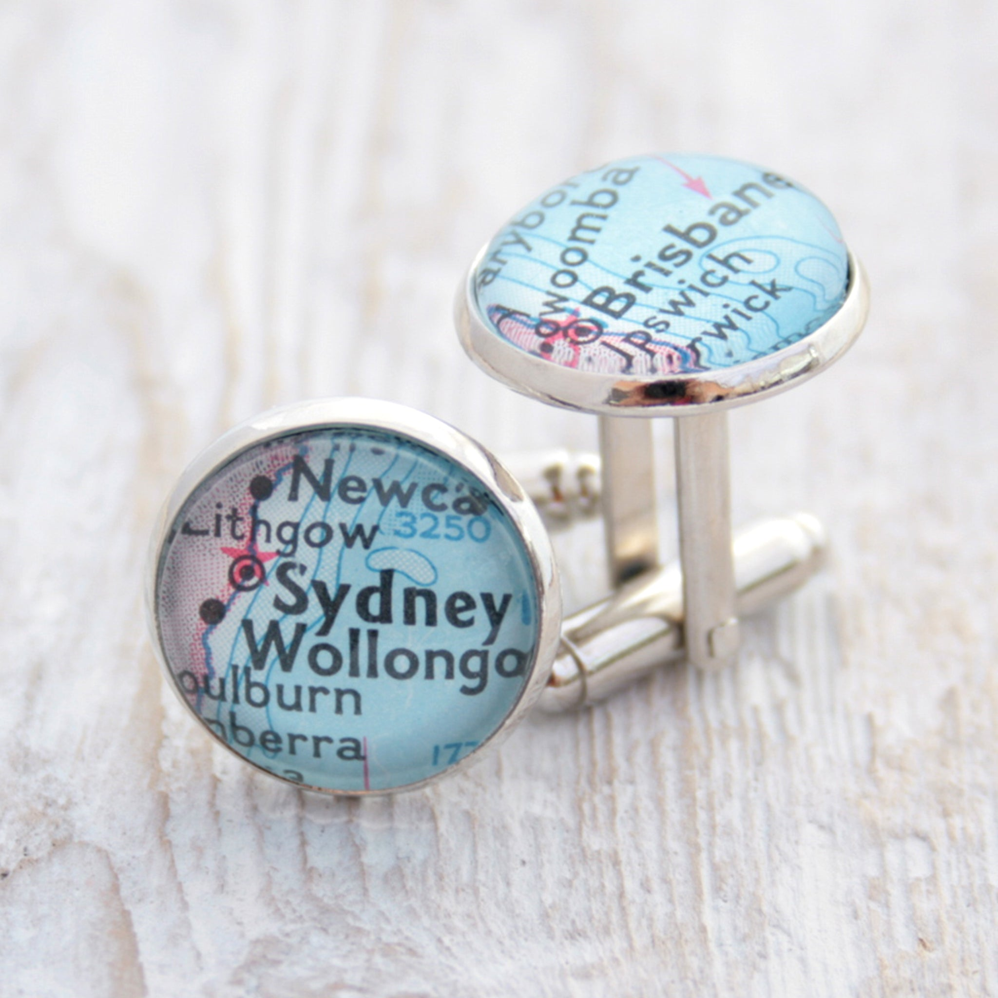 Personalised map cufflinks in silver tone featuring maps of Sydney and Brisbane