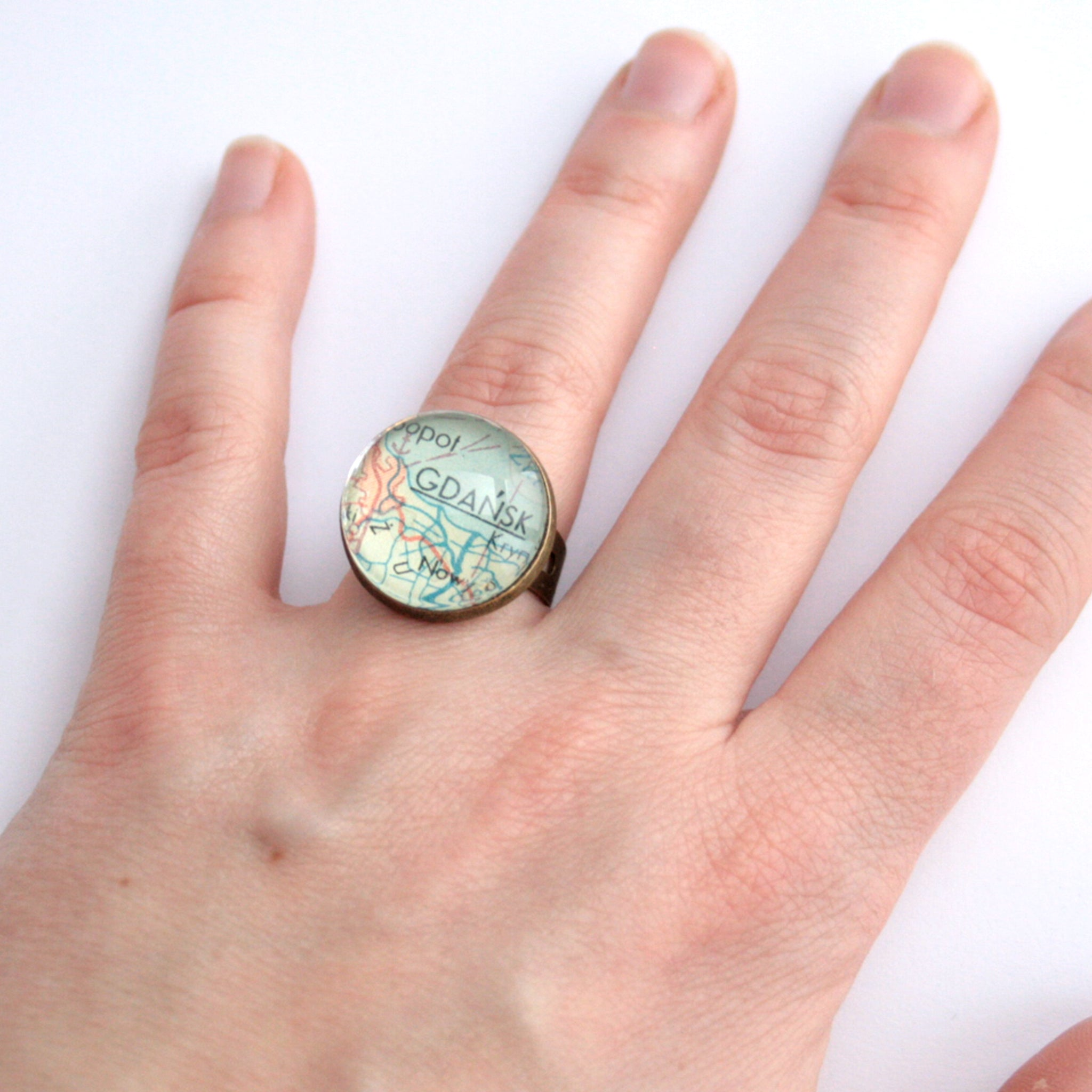 Bronze ring featuring map of Gdansk worn on hand