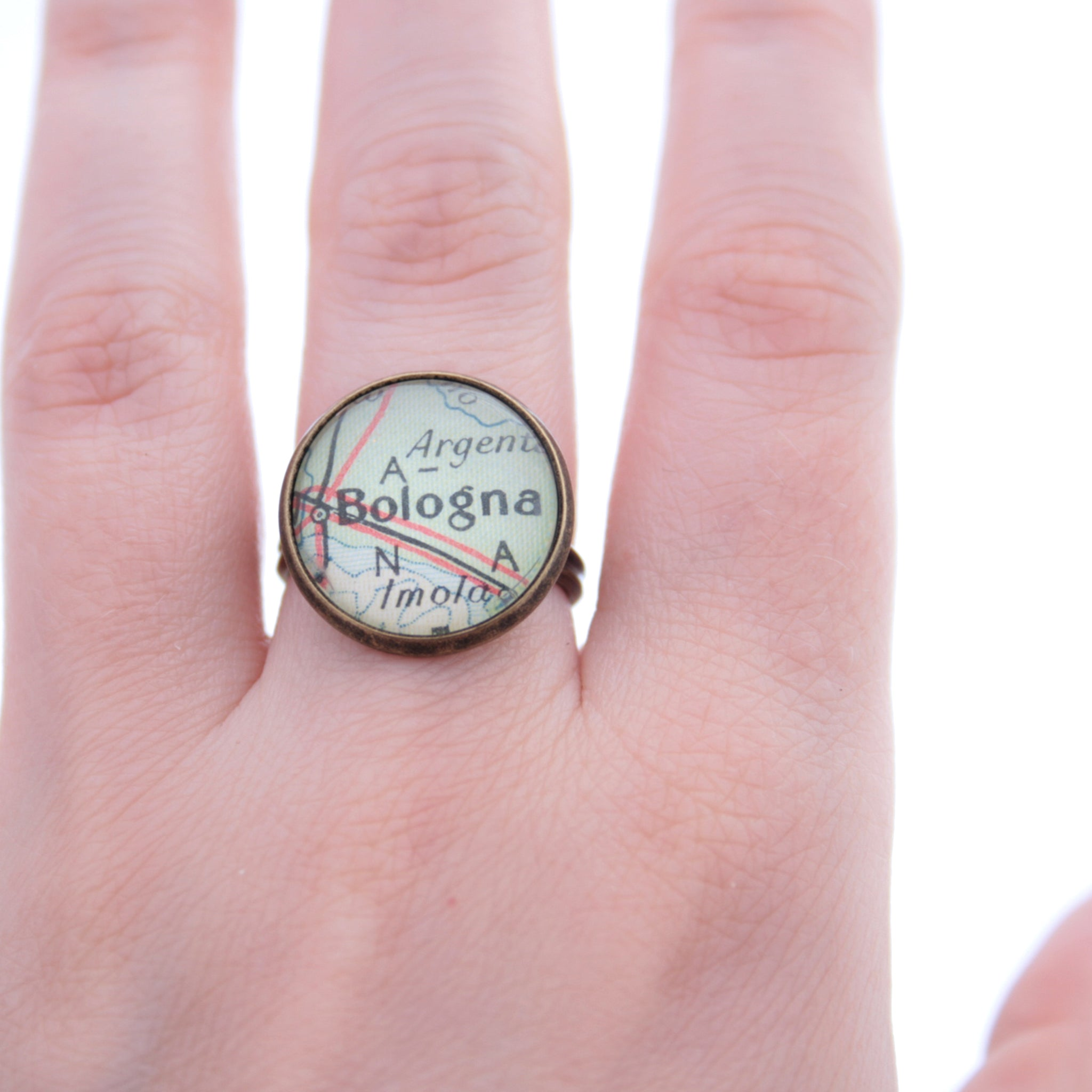 Bronze ring featuring map of Bologna worn on hand