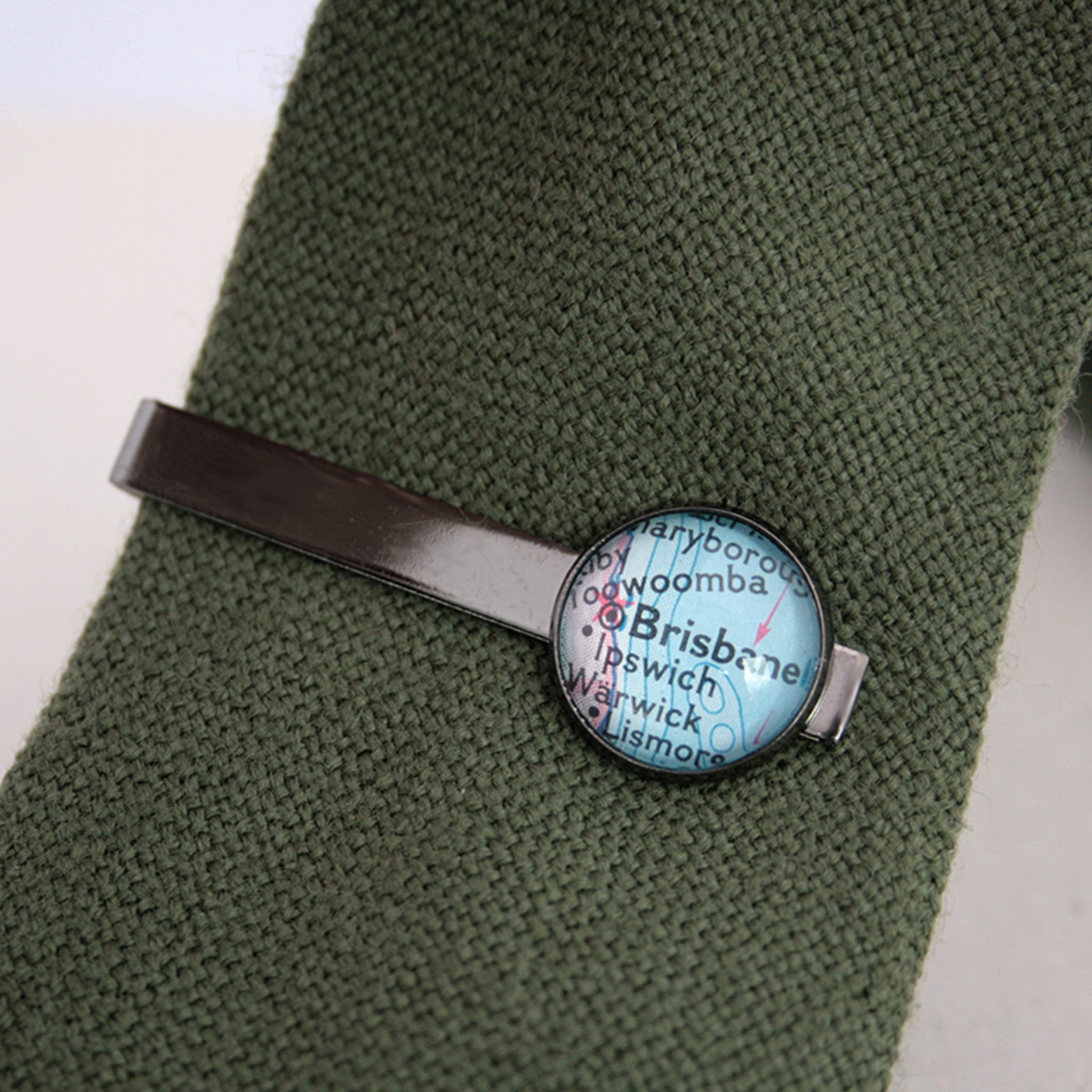 Personalised Tie Clip in gunmetal black color featuring map of Brisbane on a green tie