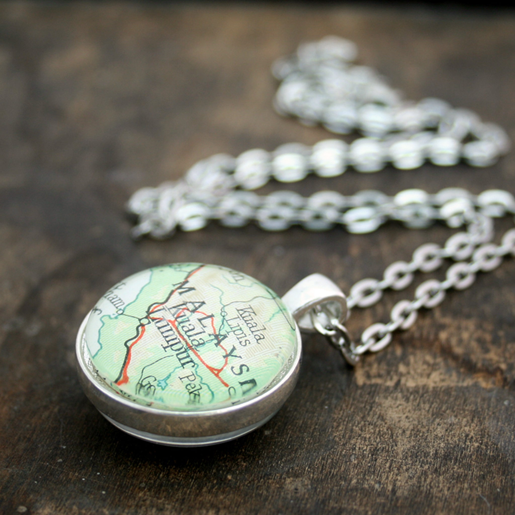 Silver tone double sided pendant necklace featuring map of Malaysia