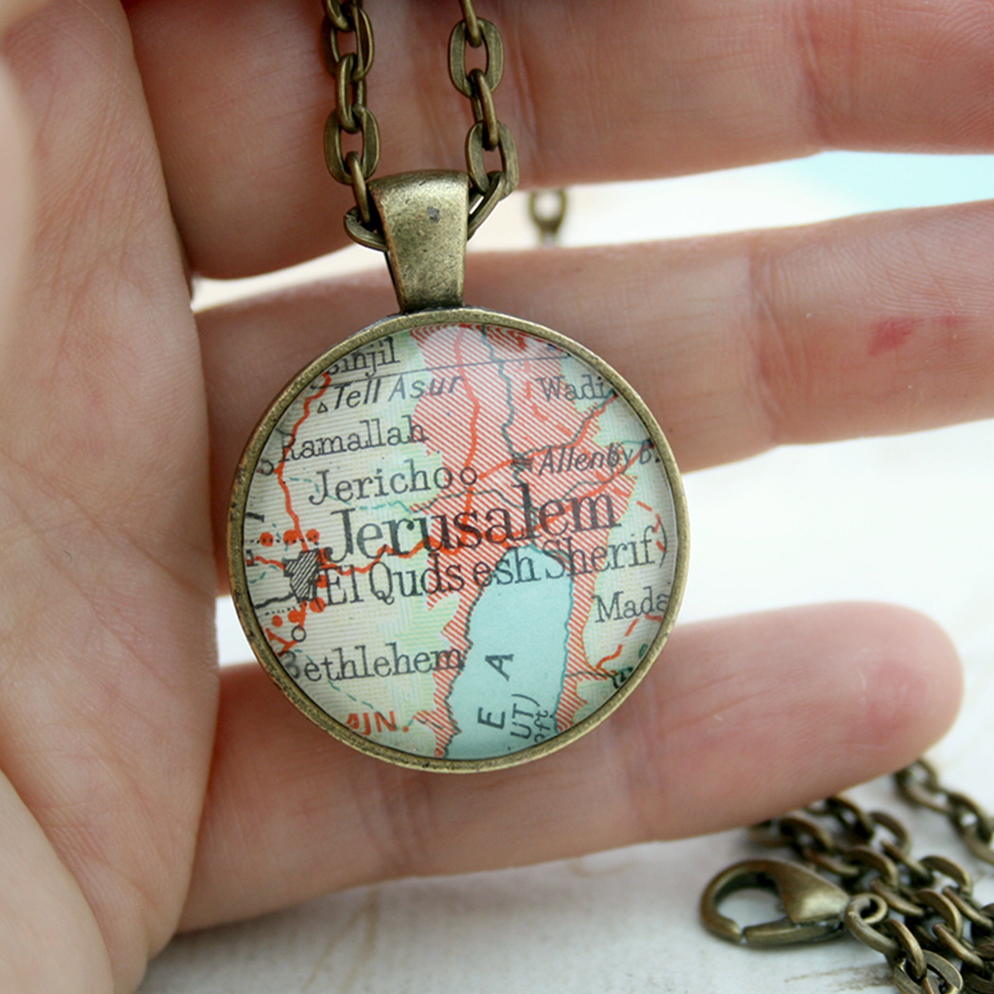 Hold in hand Bronze double sided pendant necklace featuring map of Jerusalem