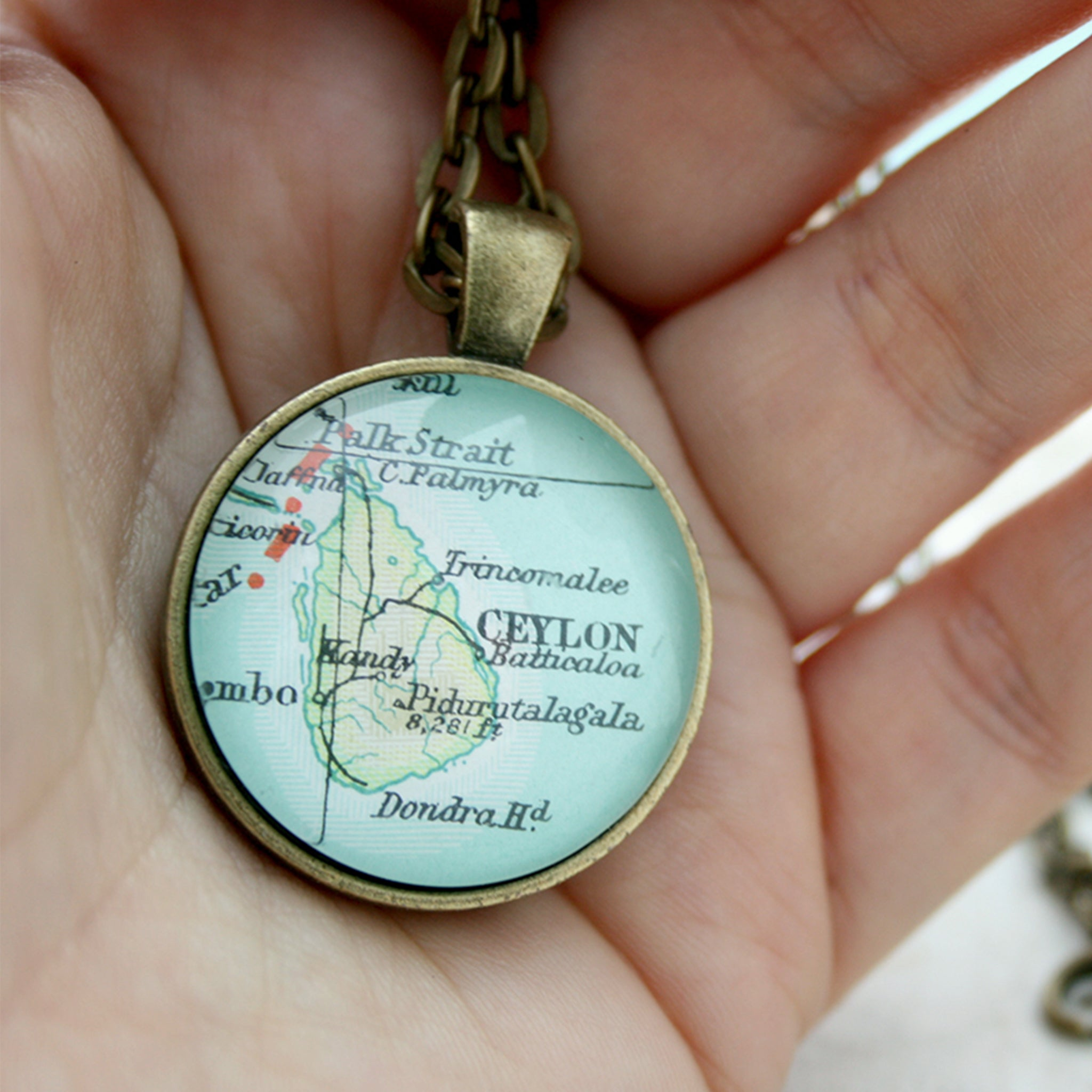 Bronze double sided pendant necklace featuring map of Ceylon