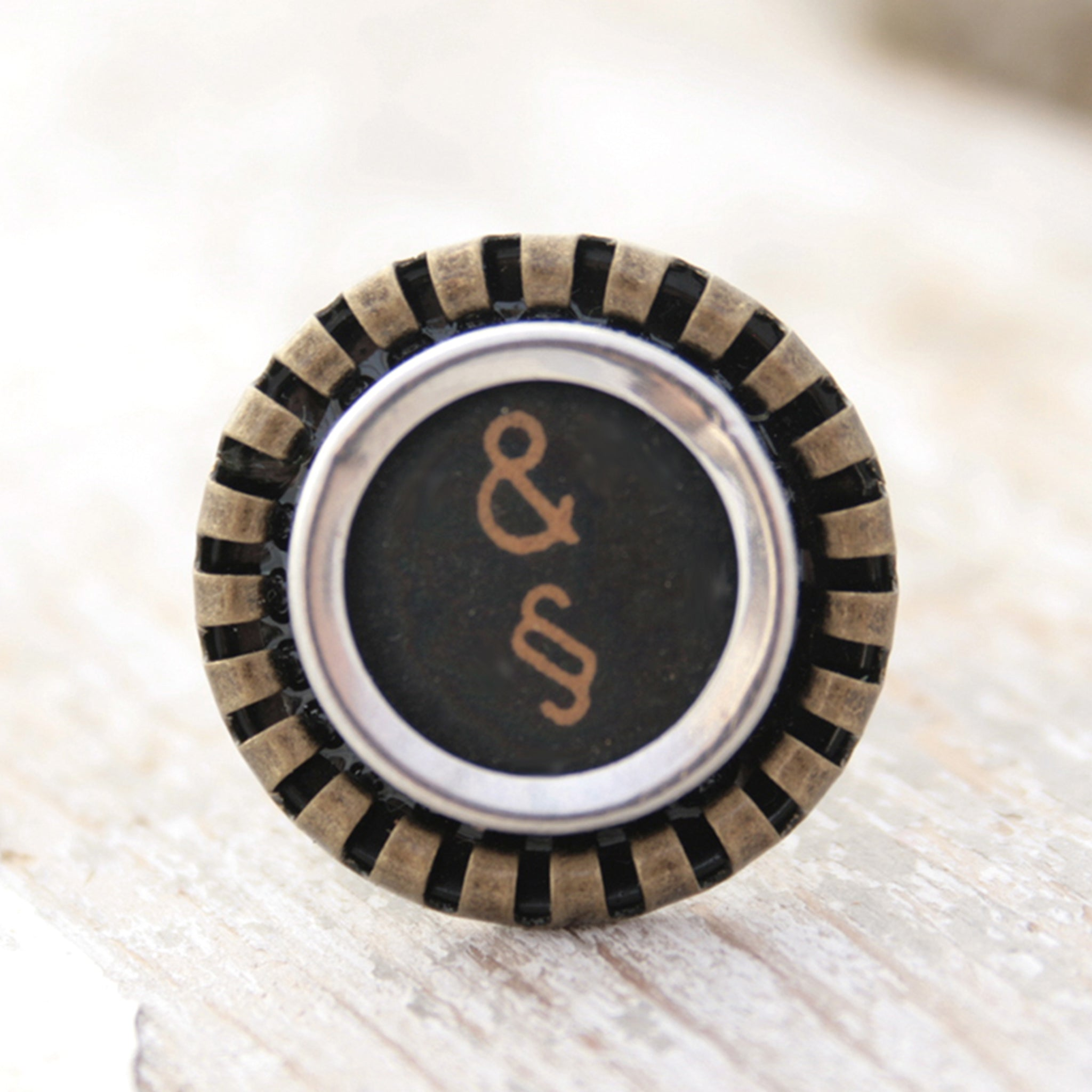 Black Ring featuring Amresand and paragraph signs made of typewriter key