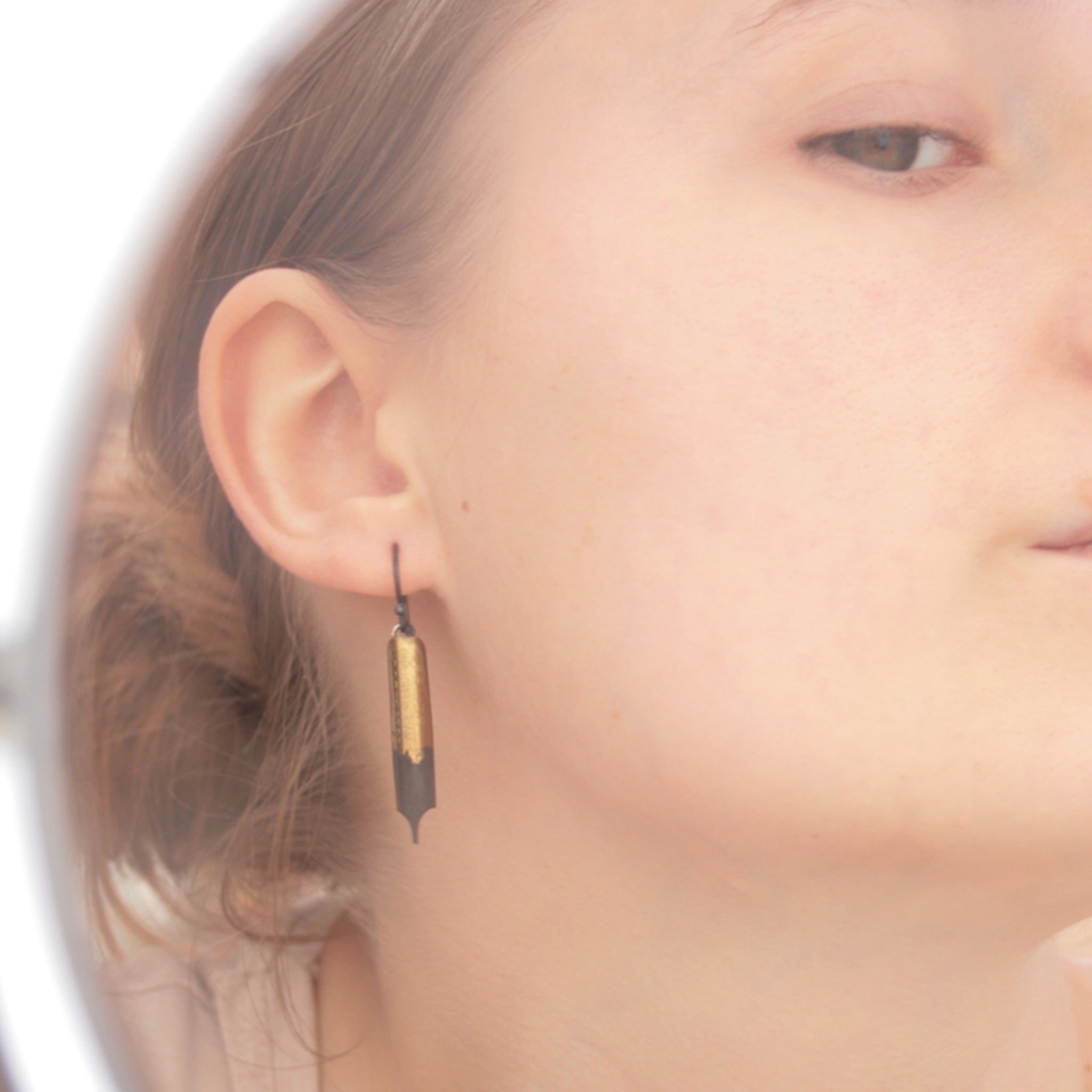 Quirky Earrings made of Pen Nibs on model
