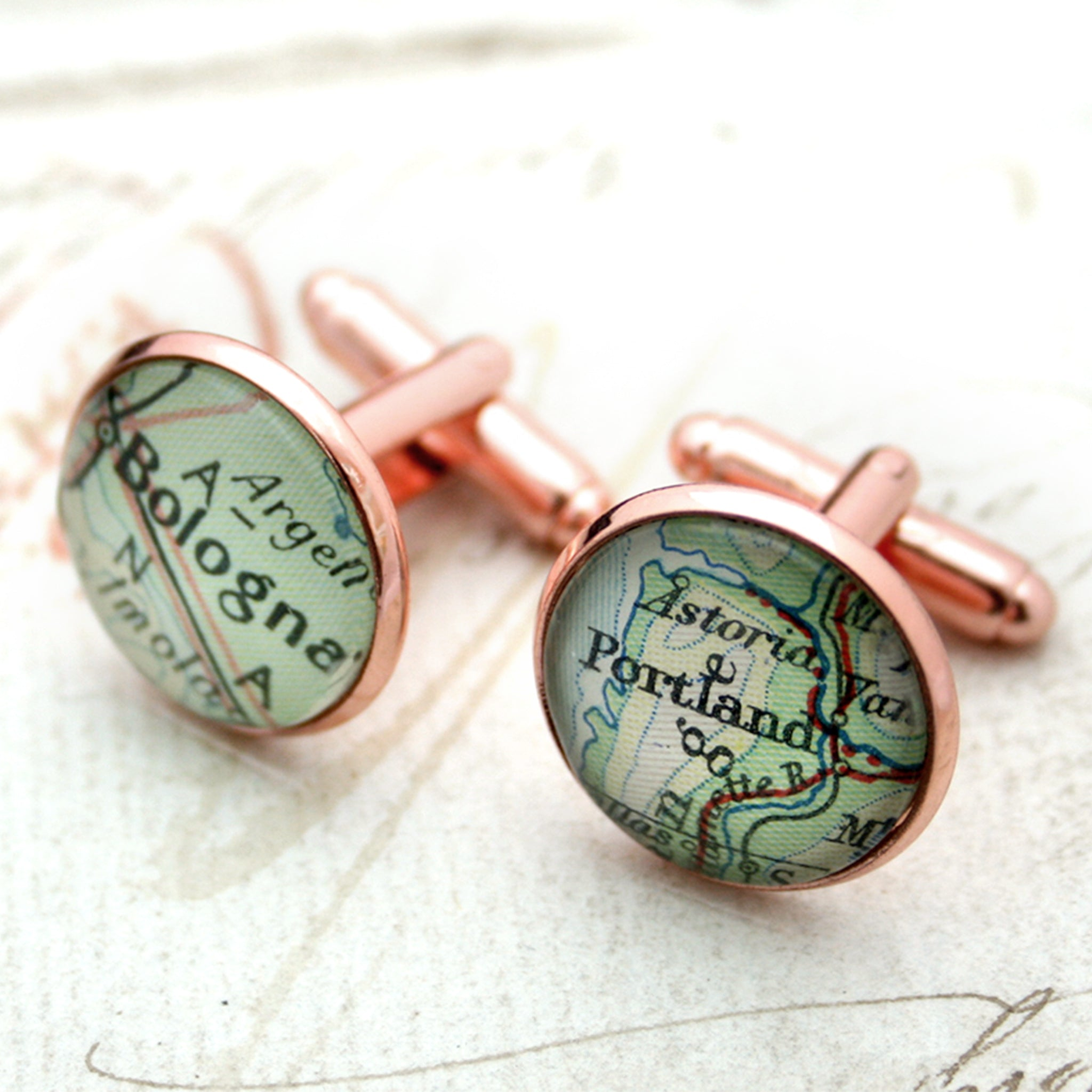 Personalised map cufflinks in rose gold color featuring Bologna and Portland