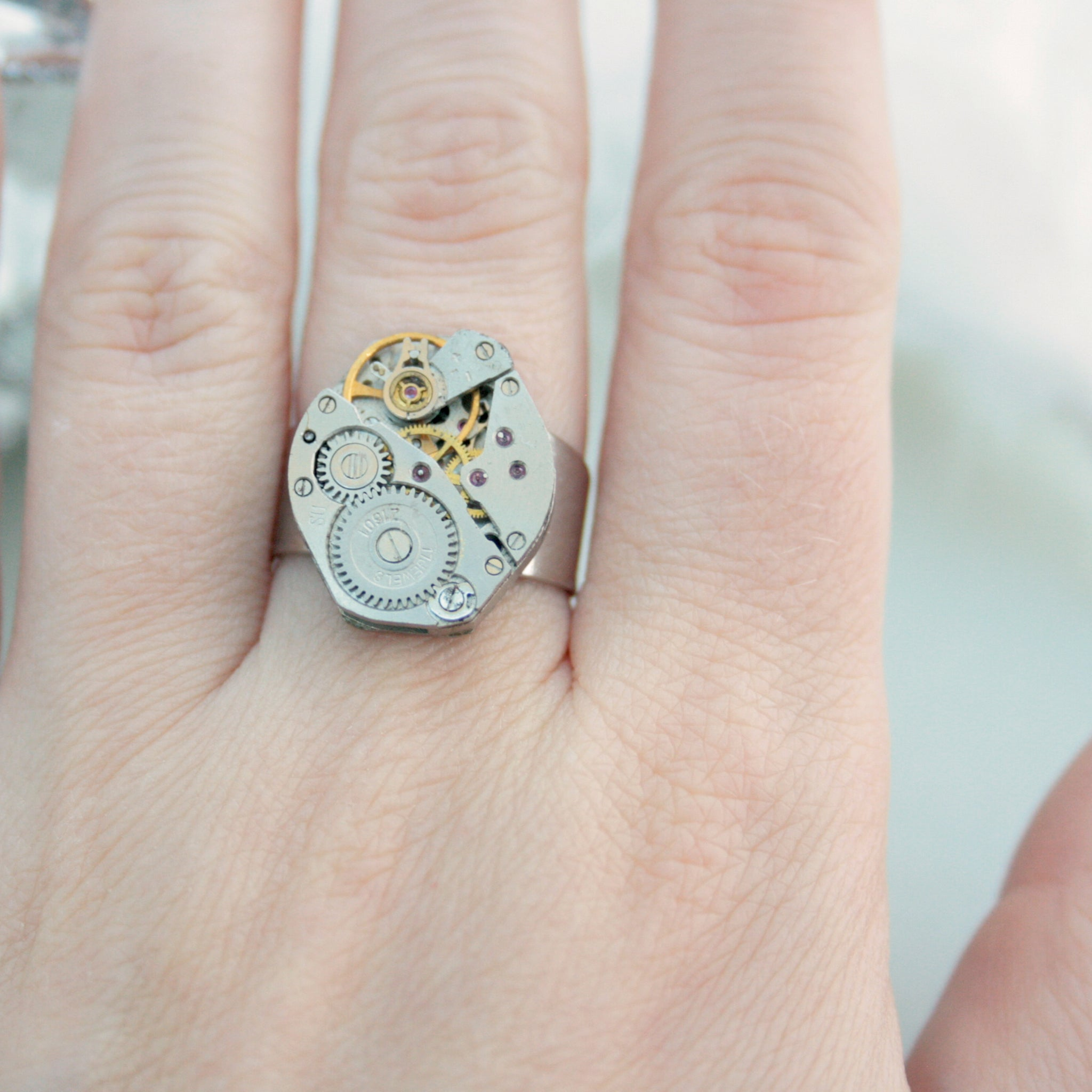 Steampunk Signet Ring made of real watch on a hand