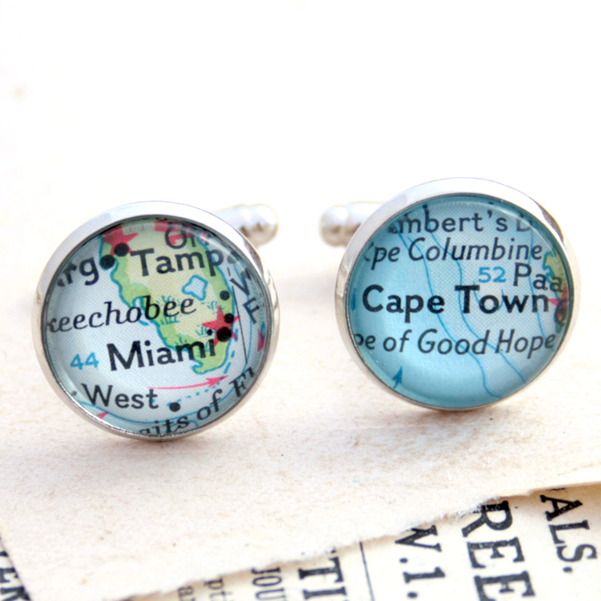 Personalised map cufflinks in silver tone featuring maps of Cape Town and Miami