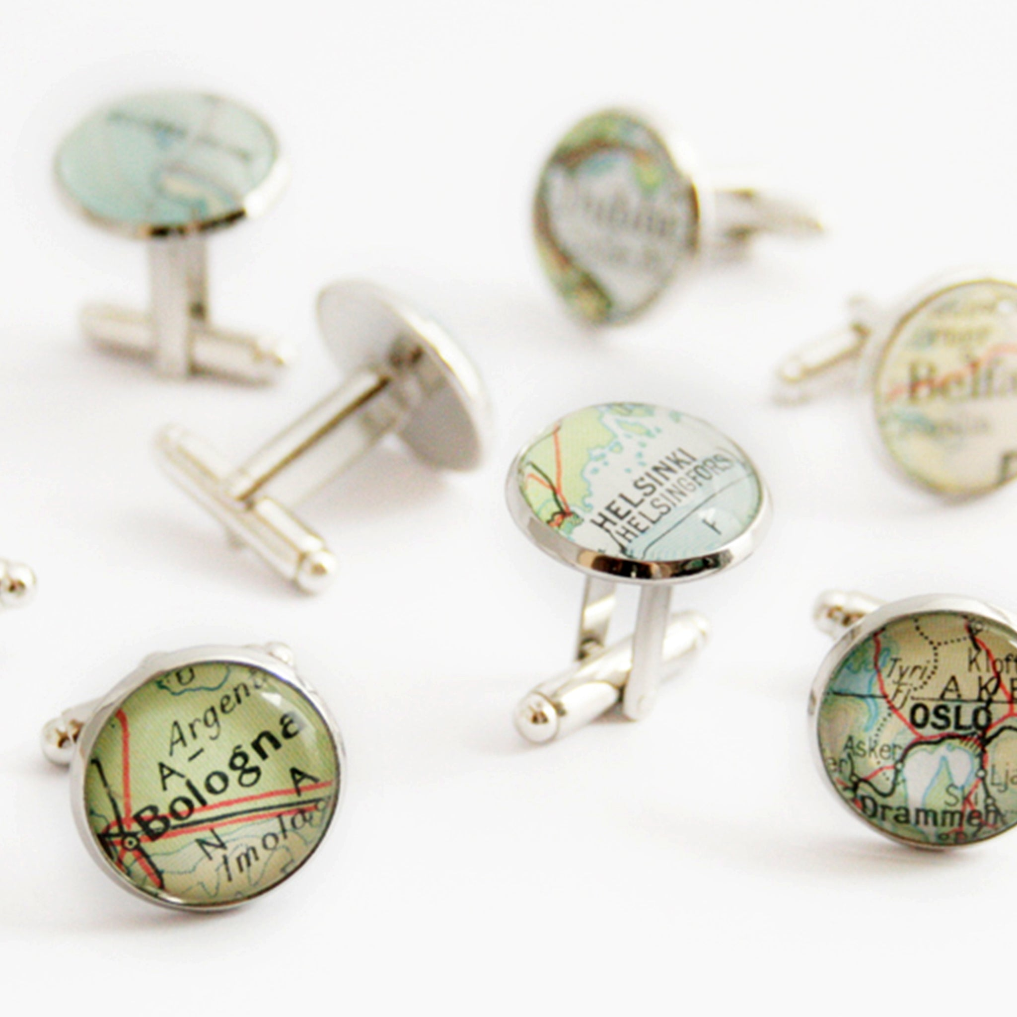 Many sets of Personalised map cufflinks in silver tone featuring custom maps