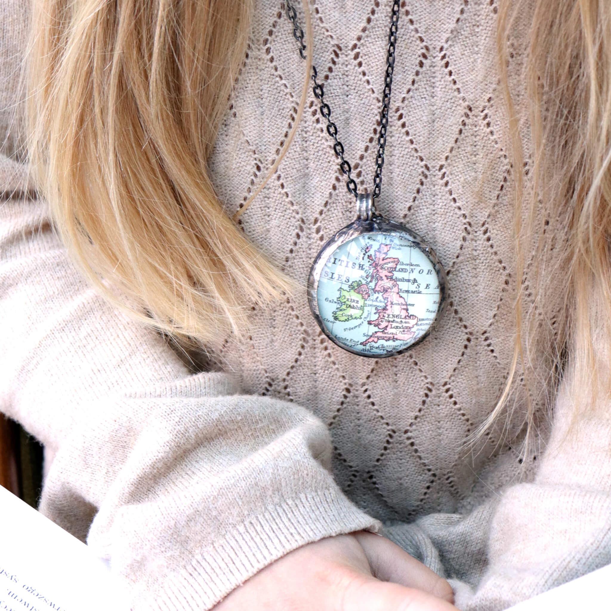 Girl wearing Tiffany style statement necklace featuring map of British Isles