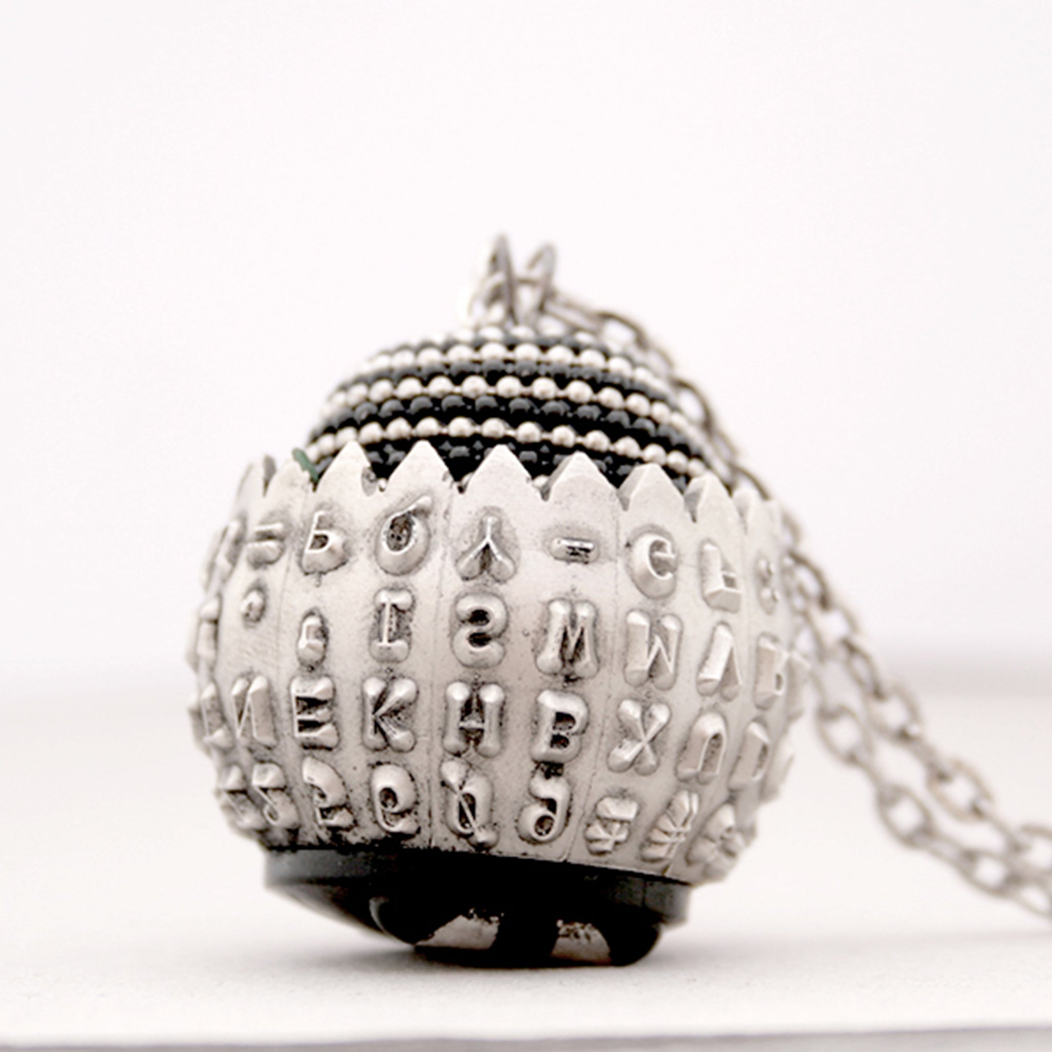 IBM Selectric typewriter font ball with large metal bead turned into eye catching necklace