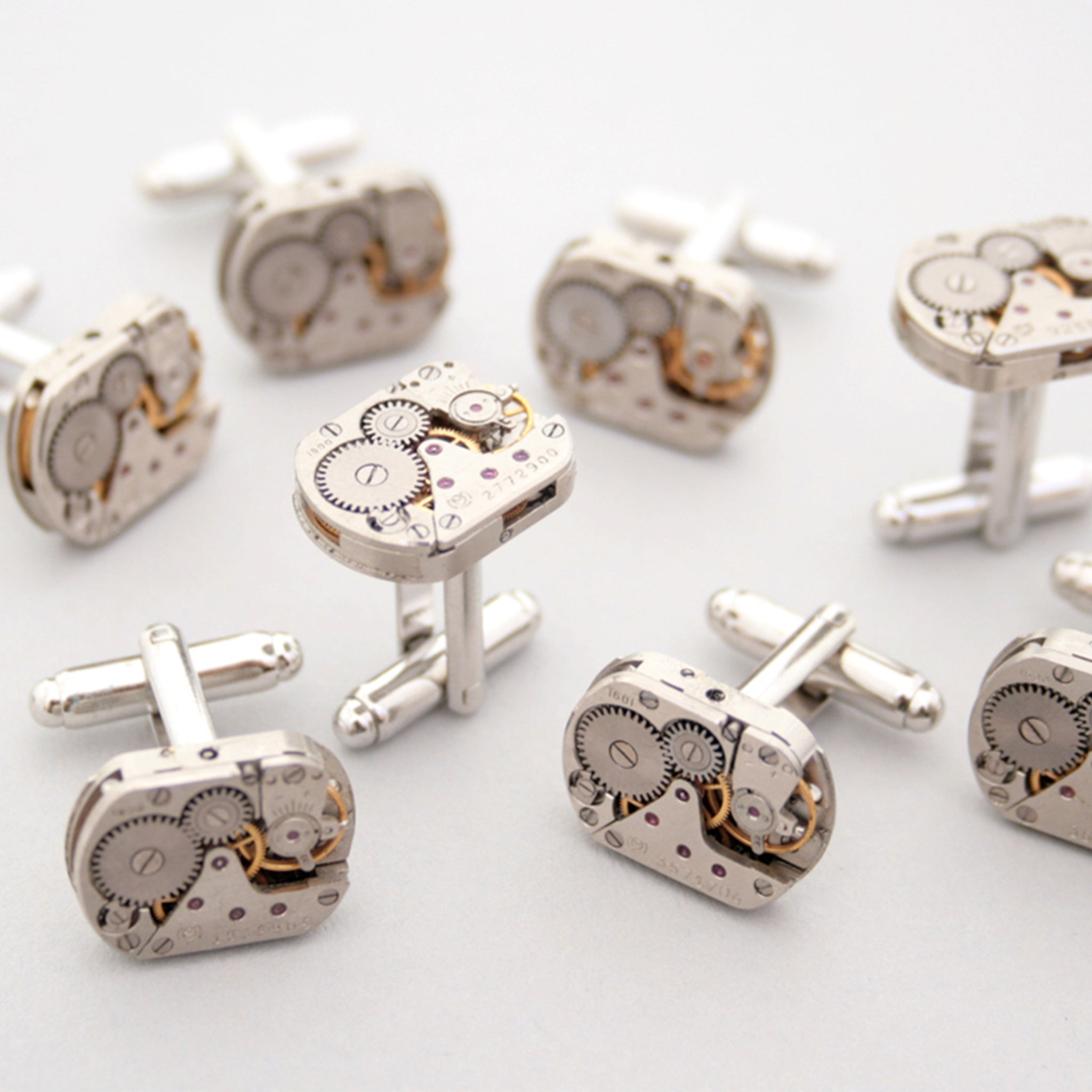 Many sets of Steampunk Cufflinks for Men featuring antique watch movements
