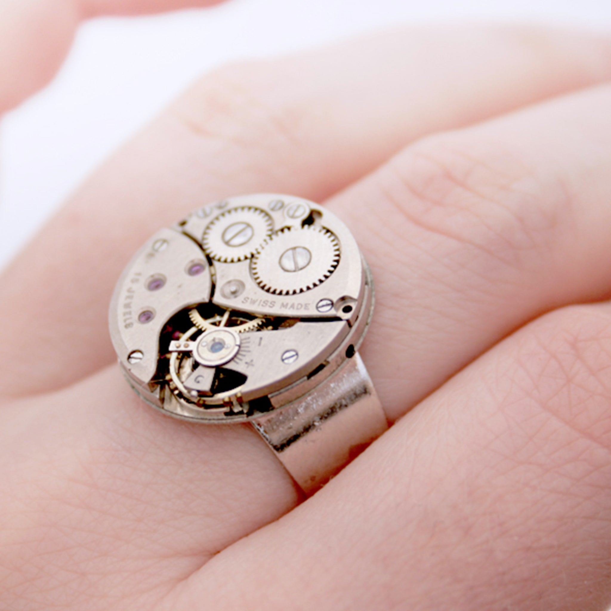 steampunk ring made of a real Swiss watch mechanism on hand